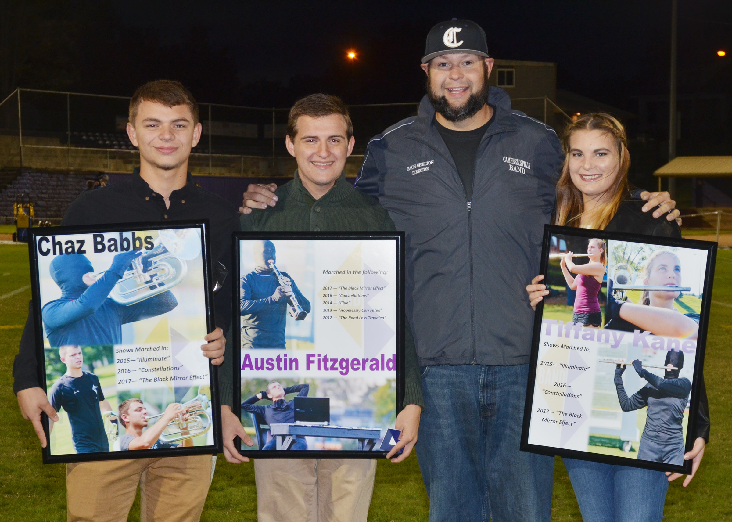 CHS Band Director Zach Shelton honors seniors, from left, Chaz Babbs, Austin Fitzgerald and Tiffany Kane. Darius Wright is absent from the photo.