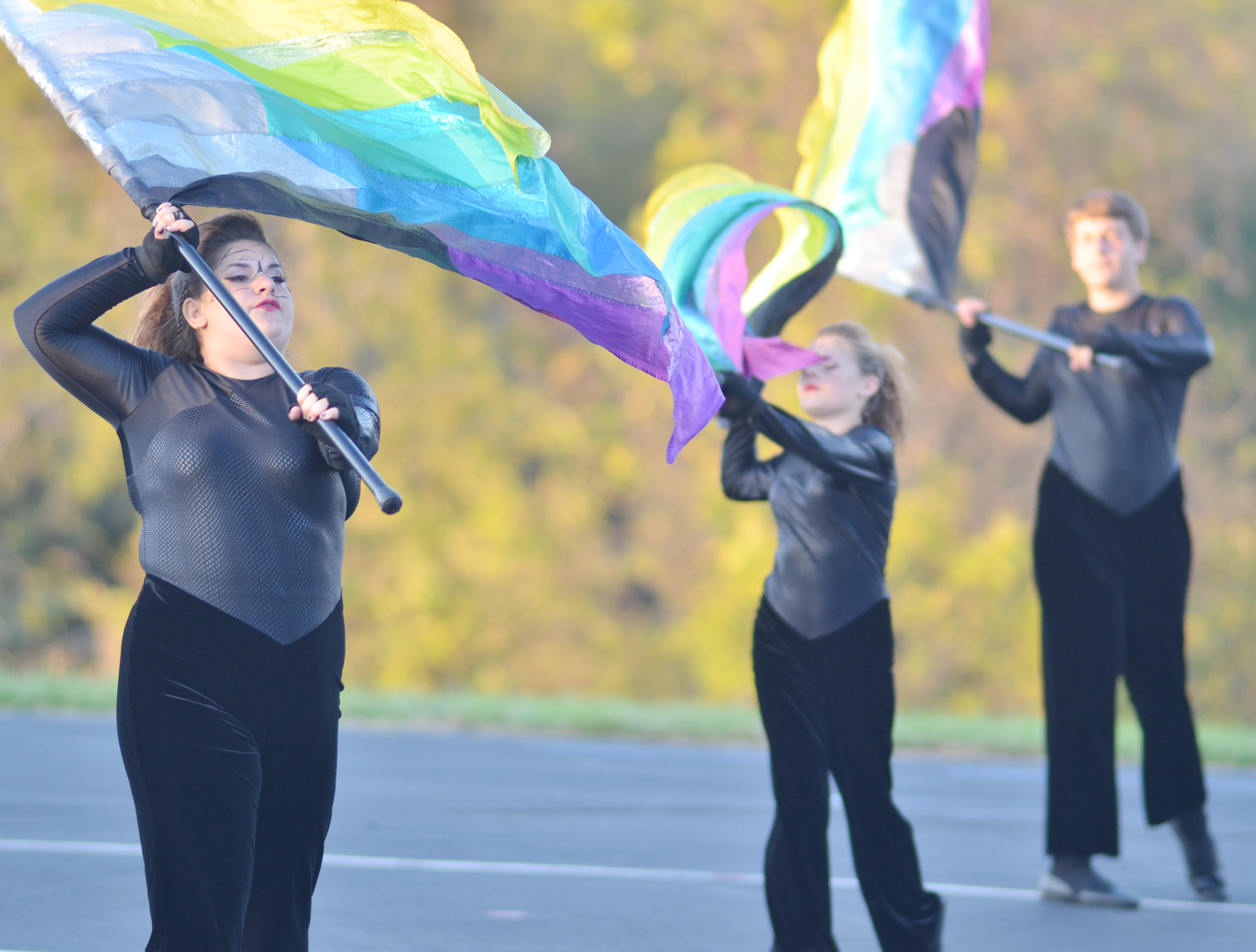 Color guard members, from left, CHS sophomore Brandy Miller, Campbellsville Middle School seventh-grader Alyssa Orberson and CHS freshman Nick Drew warm up.