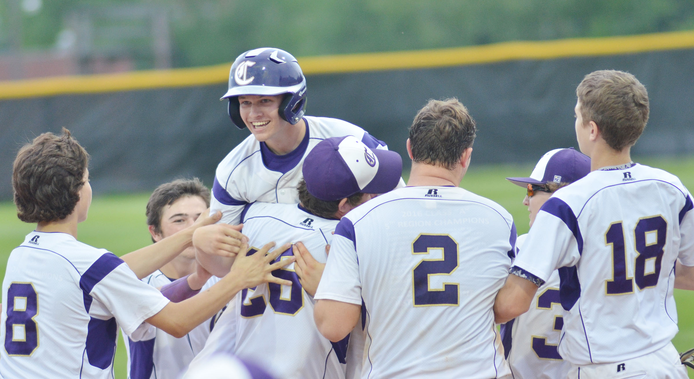 Teammates congratulate CHS junior Wyatt Houk after he gets the game-winning hit.