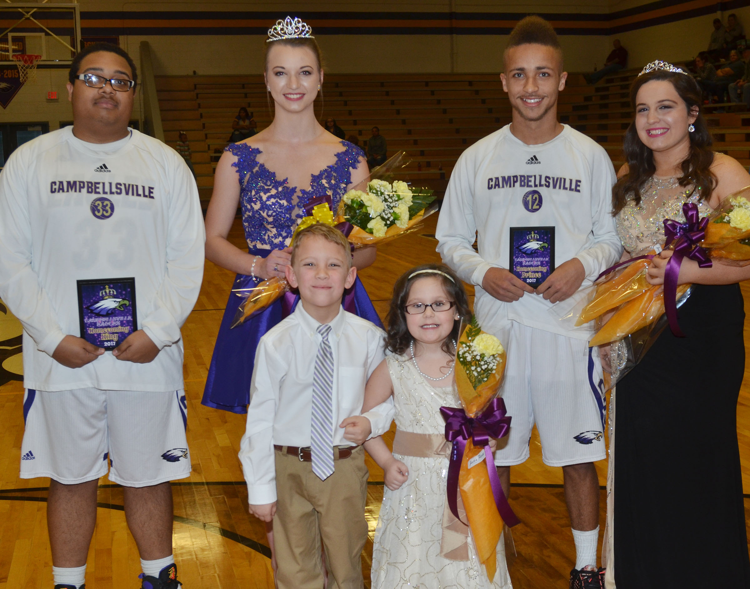 CHS seniors Ricky Smith-Cecil and Caylie Blair, at left, were named this year's basketball homecoming king and queen. Ethan Lay and Caitlin Bright, representing the junior class, at right, were named prince and princess. Campbellsville Elementary School first-grader Gabe Prior and kindergartener Trinity Clark were the crown bearers.