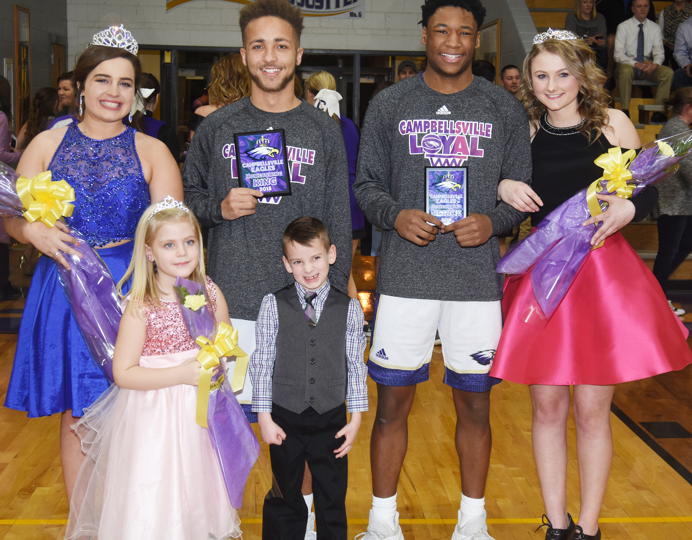 CHS seniors Caitlin Bright and Ethan Lay, at left, were named this year's basketball homecoming queen and king. Taj Sanders and Victoria Cox, representing the junior and sophomore classes, respectively, were named prince and princess. Campbellsville Elementary School kindergarteners Remi Petett and Cash Cowan were the crown bearers.