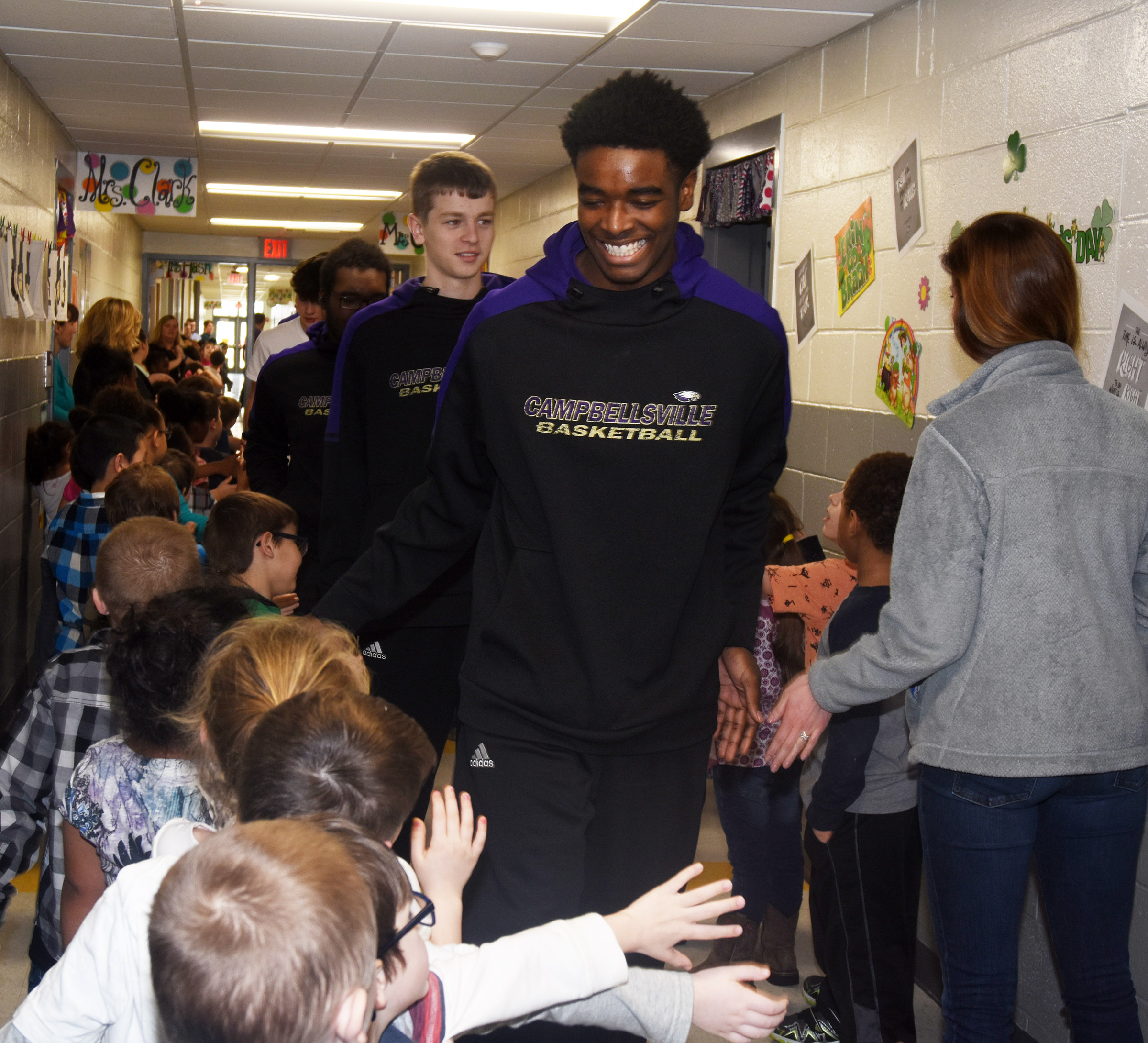 CHS senior Chanson Atkinson high-fives CES students during the Eagle Walk.