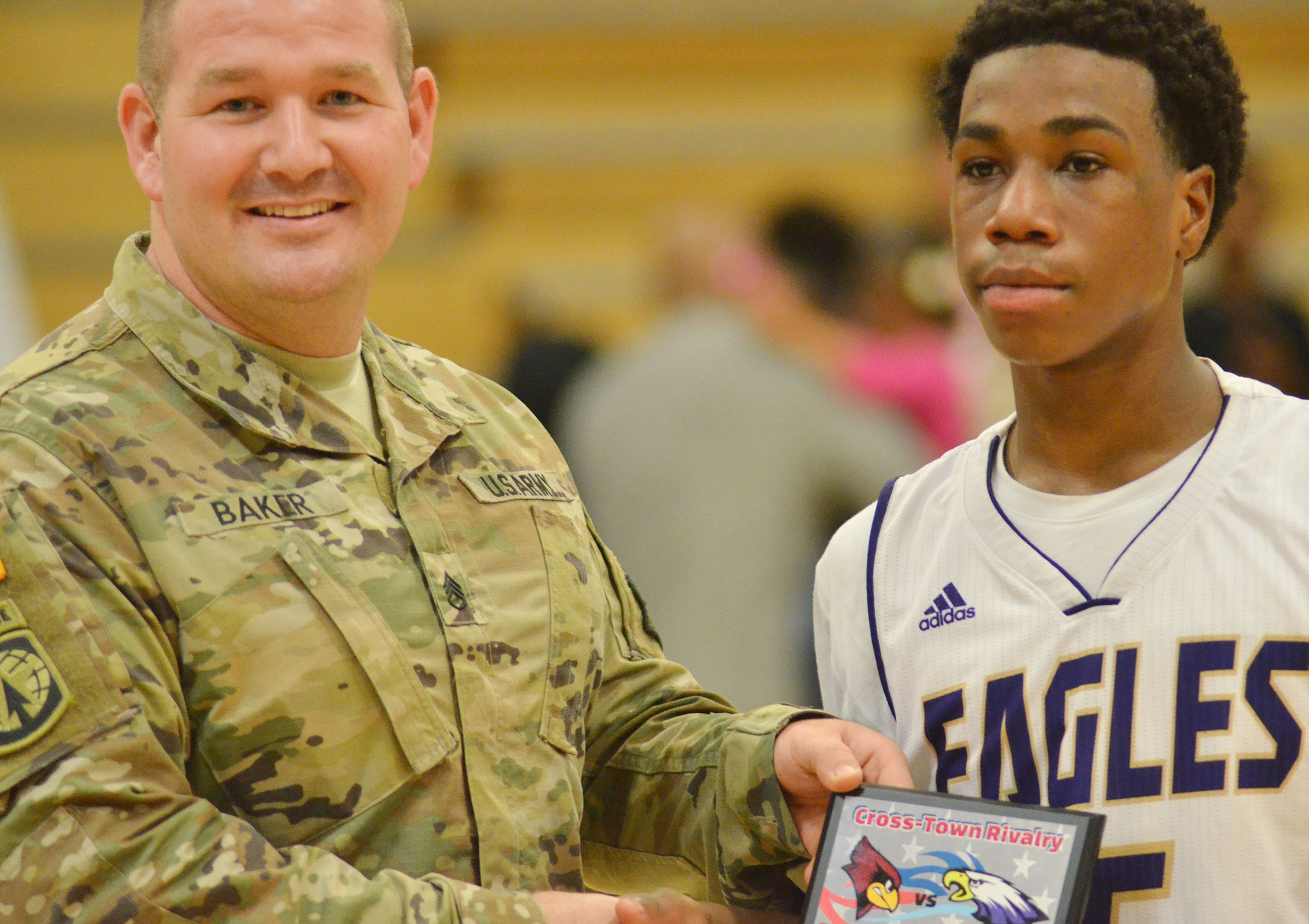CHS freshman Malachi Corley receives the Player of the Game award from Army National Guard Sgt. Phillip Baker.