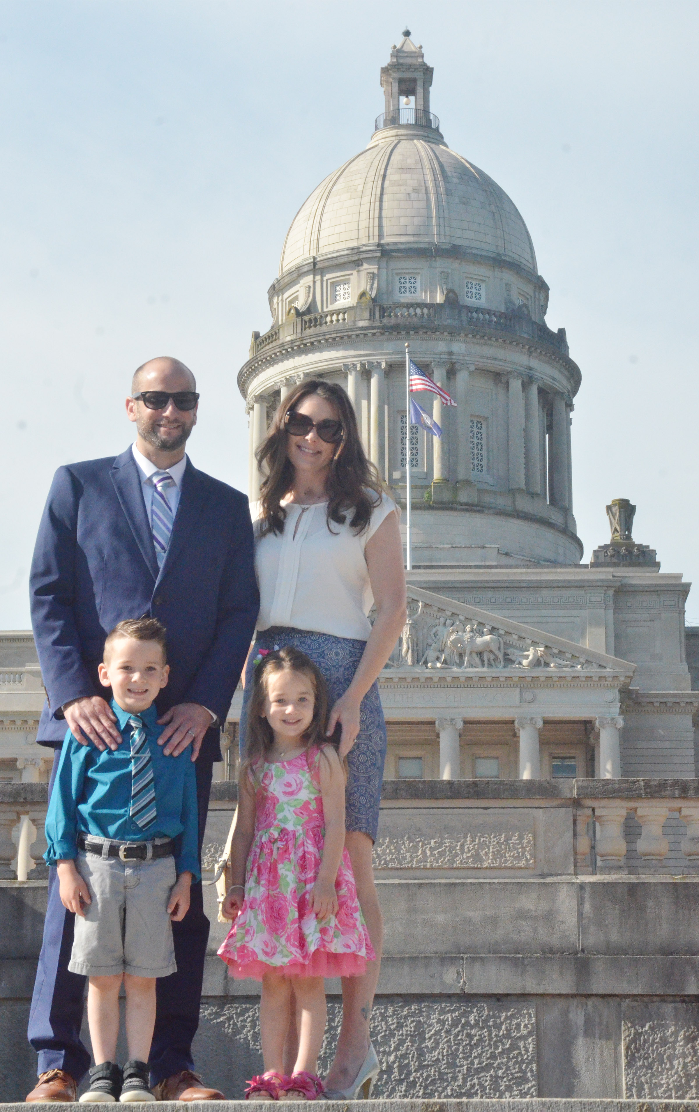 CHS teacher Ben Davis and his wife, Stephanie, pose for a photo in front of the Kentucky capitol with their children Cash and Lylah.