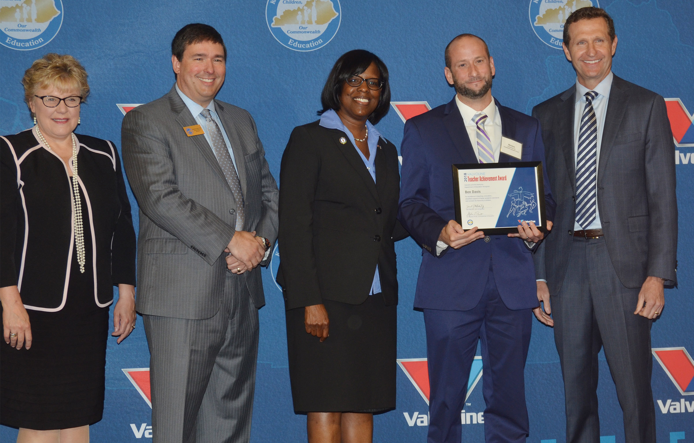 CHS teacher Ben Davis, fourth from left, receives his Teacher Achievement Award. Pictured with Davis are, from left, Mardi Montgomery, director for policy and legislation at the Kentucky Education and Workforce Development Cabinet; Commissioner of Education Dr. Stephen Pruitt; Kentucky Lt. Gov. Jenean Hampton and Sam Mitchell, chief executive officer of Valvoline.