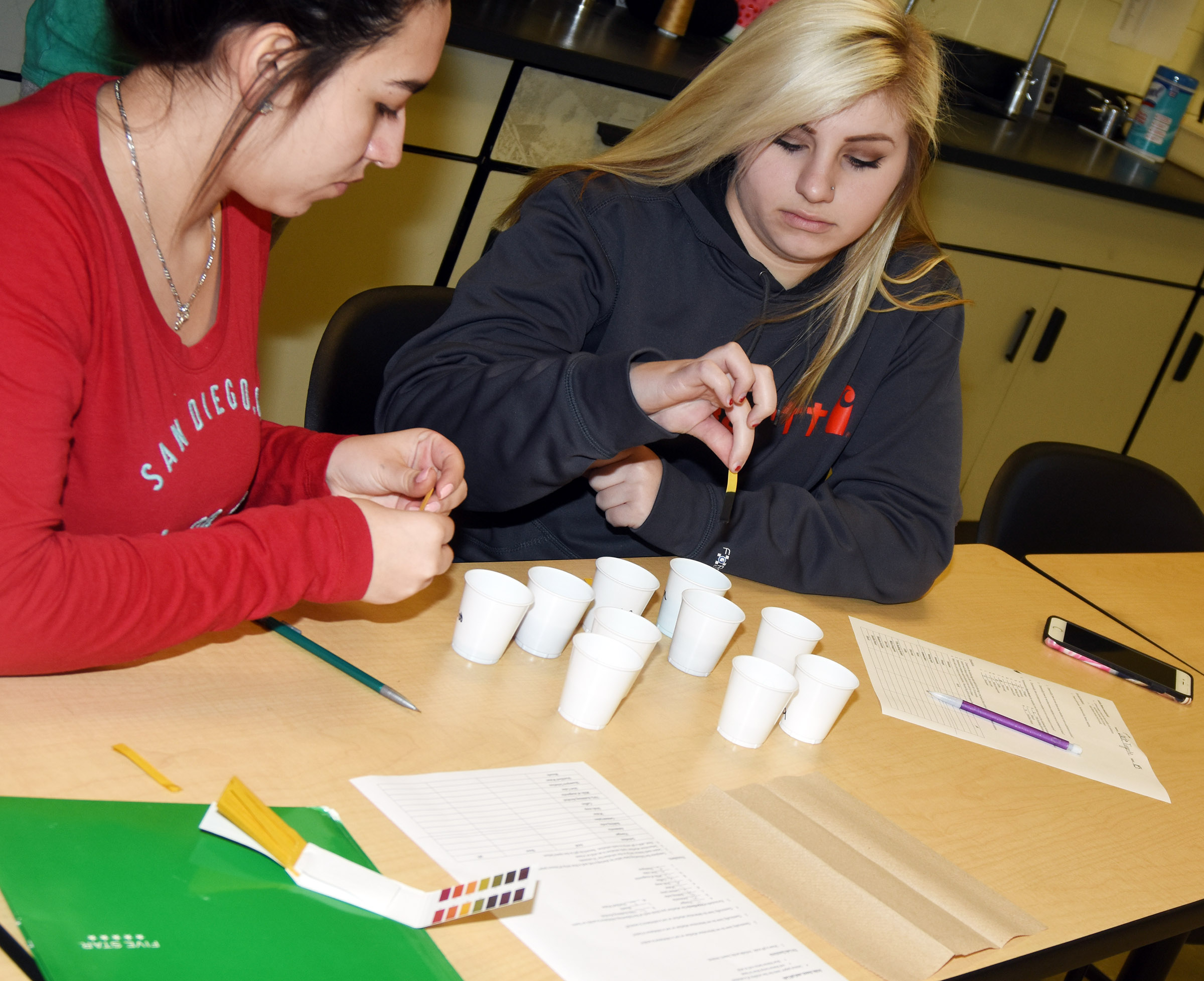 CHS sophomores Amaurie Deleon, at left, and Jade Tungate perform a litmus test.