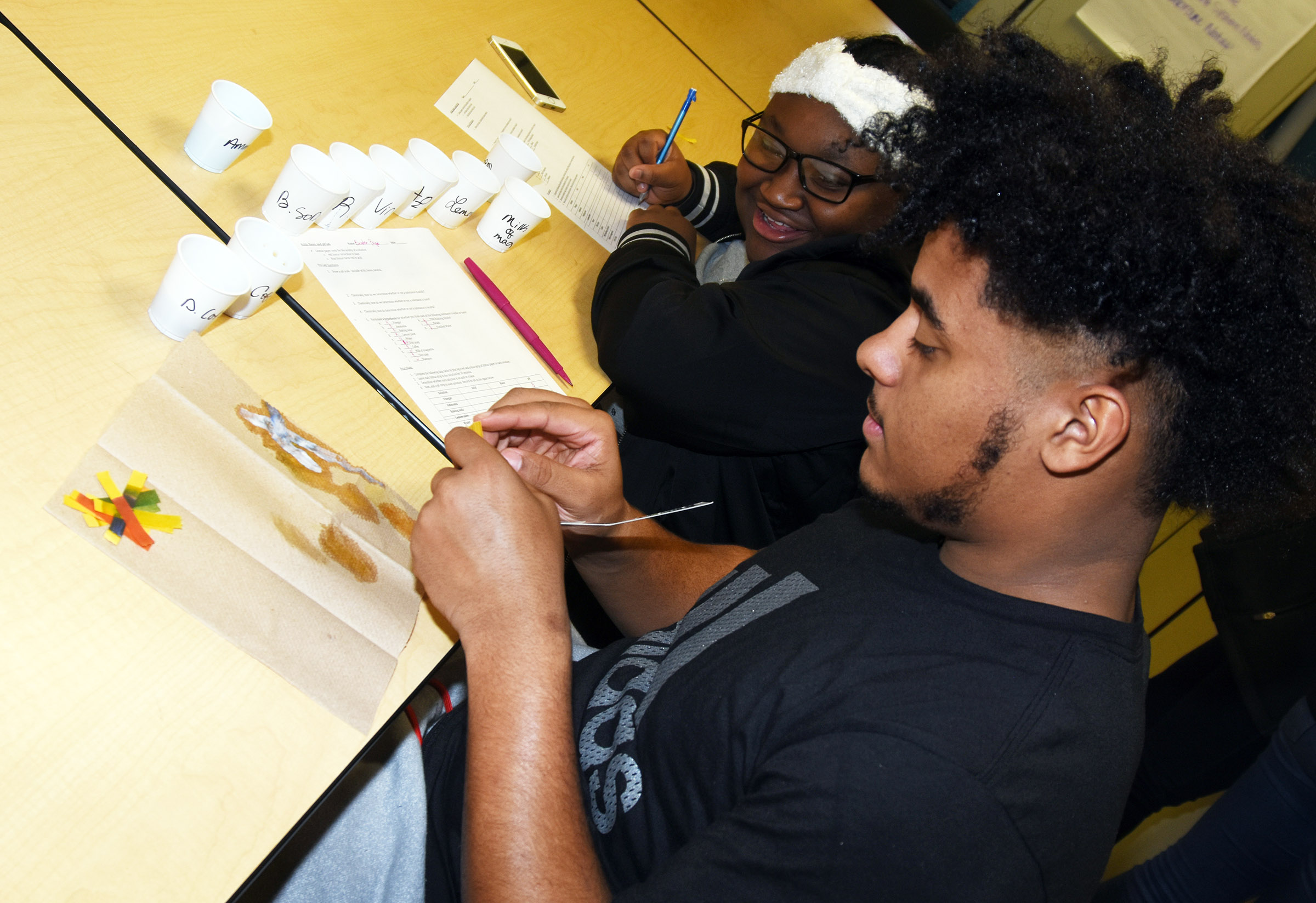 CHS sophomores Ashalique Adams, at left, and Braden Paige perform a litmus test.