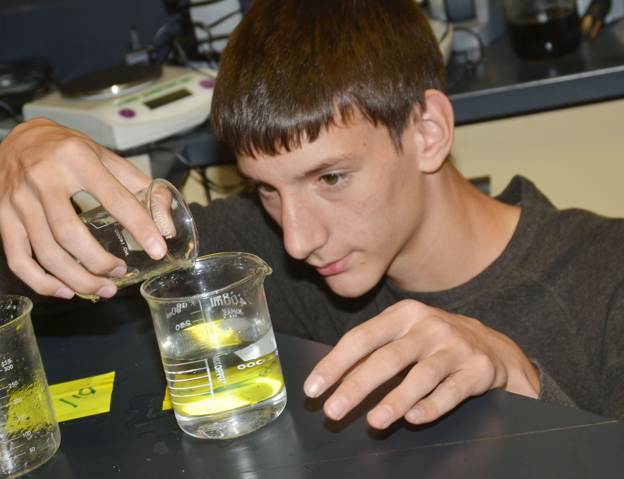 CHS sophomore Evan McAninch sees how vegetable oil changes the properties of water.