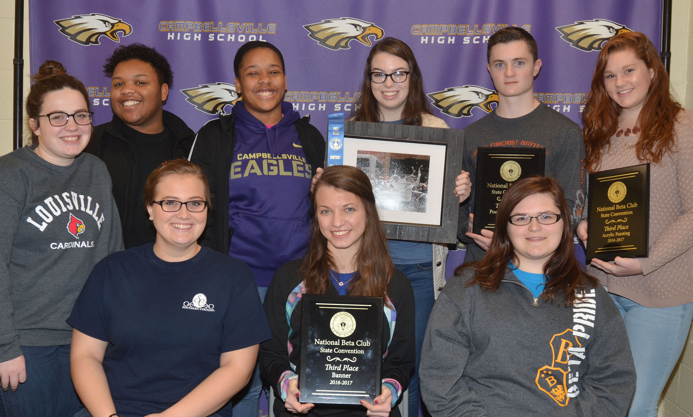 Campbellsville High School Beta Club members brought home several awards on Tuesday, Jan. 24, from this year's state convention. They now advance to the national Beta convention this summer. They are, from left, front, seniors Brenna Wethington, Caylie Blair and Vera Brown, who placed third in the banner competition. Back, juniors Caitlin Bright, Darius Wright and Kayla Young, who were in the Top 10 in the spotlight on service category; senior Laura Lamb, who received first place in the photography category; junior Bryce Richardson, who received third place in poetry; and senior Mallory Haley, who received third place in on-site acrylic painting.