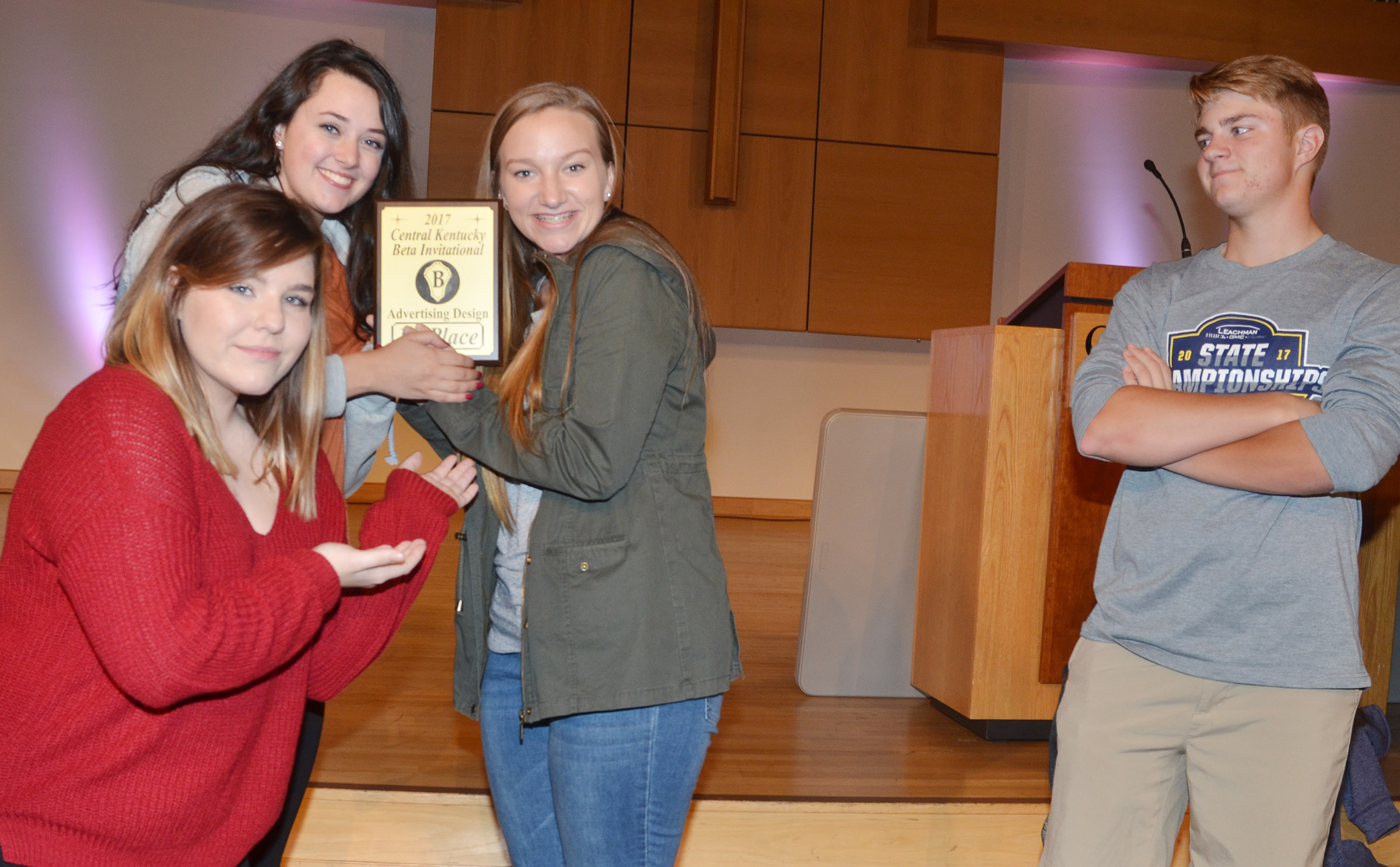 CHS Beta Club members brought home several awards on Thursday, Oct. 19, at the annual Central Kentucky Beta Invitational. From left, seniors Sara Farmer, Missy Vanorder and Madison Dial hold their third place advertising design plaque as their teammate, senior Alex Doss, looks on.