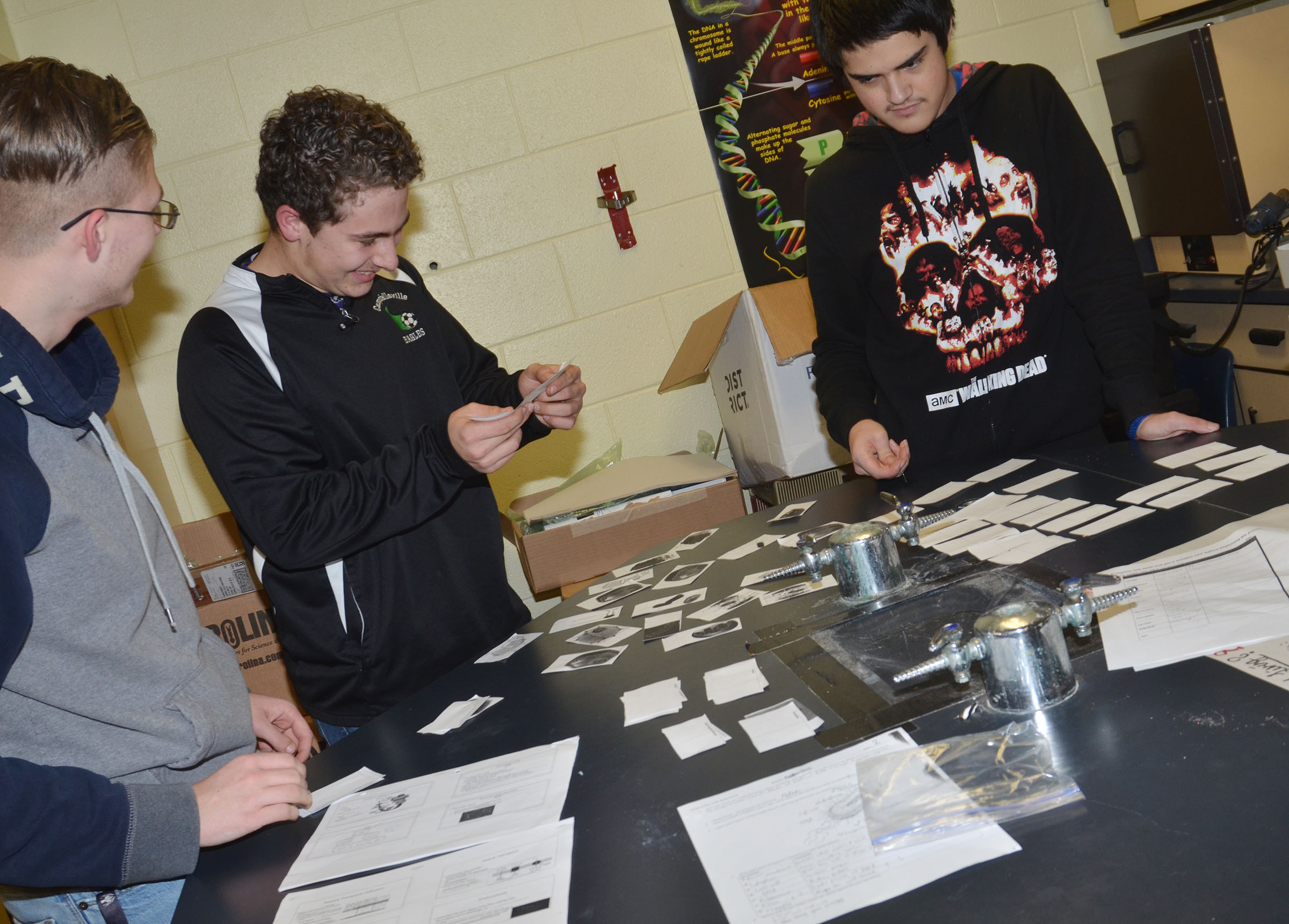 CHS sophomores, from left, Keidlan Boils, Brody Weeks and Seth Tindal try to match their photos of the parts of a cell with their names.