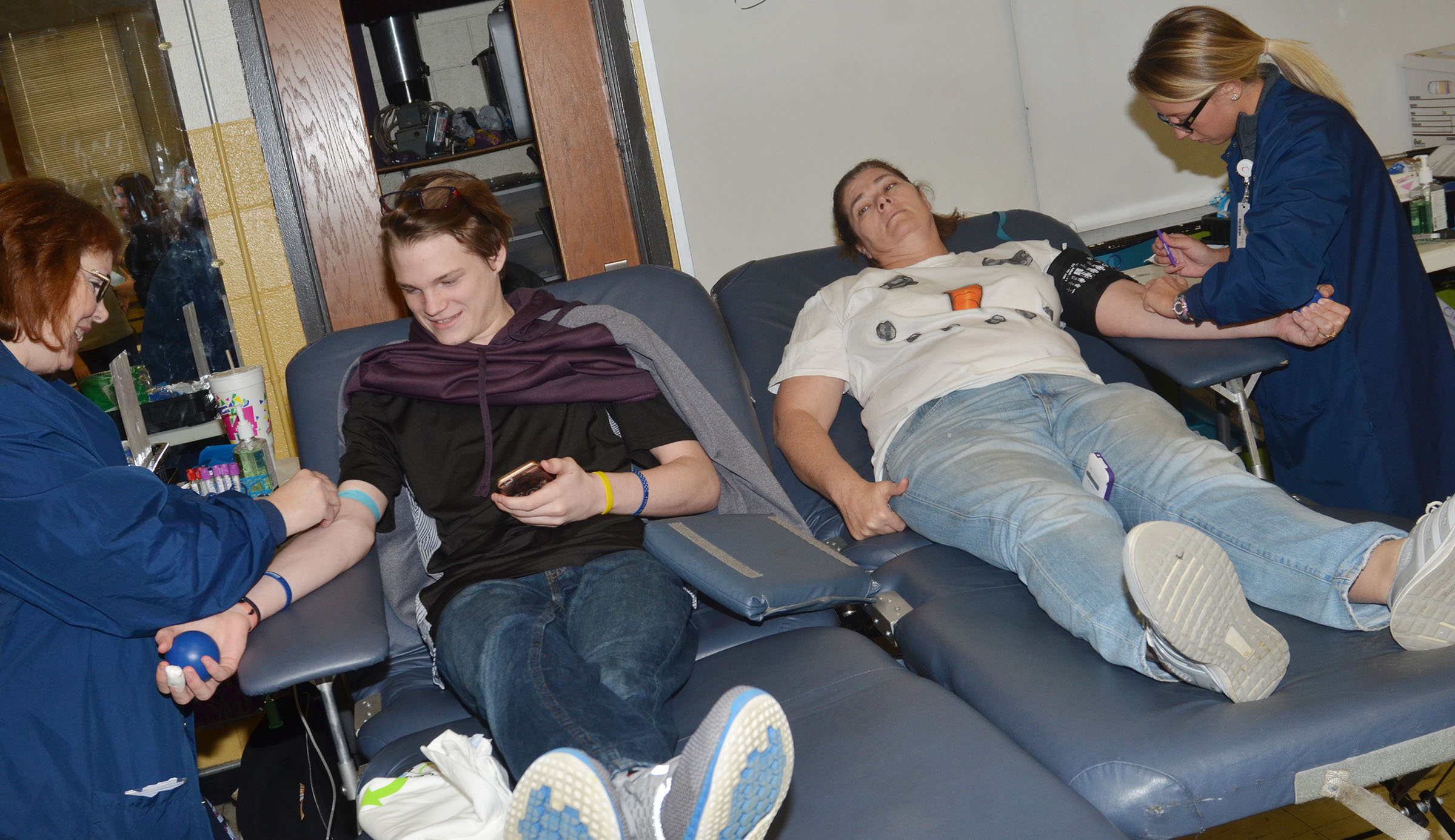 CHS sophomore Joe Pipes, at left, and teacher Tammy Wilson donate blood.