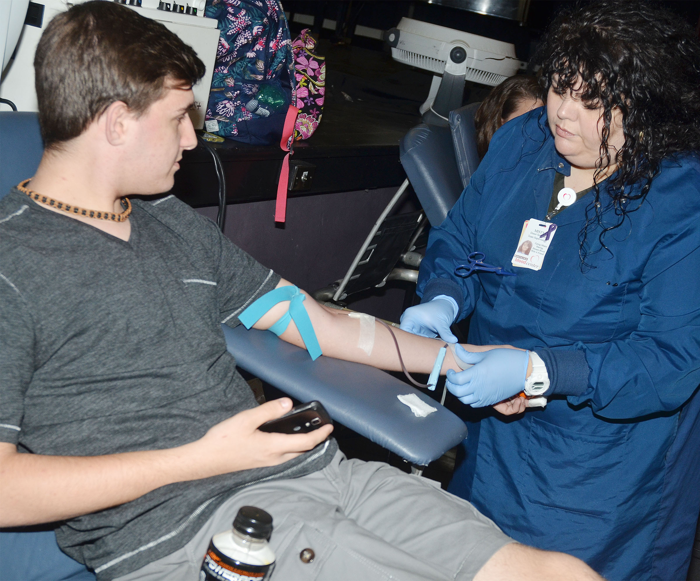 CHS junior Austin Fitzgerald donates blood.
