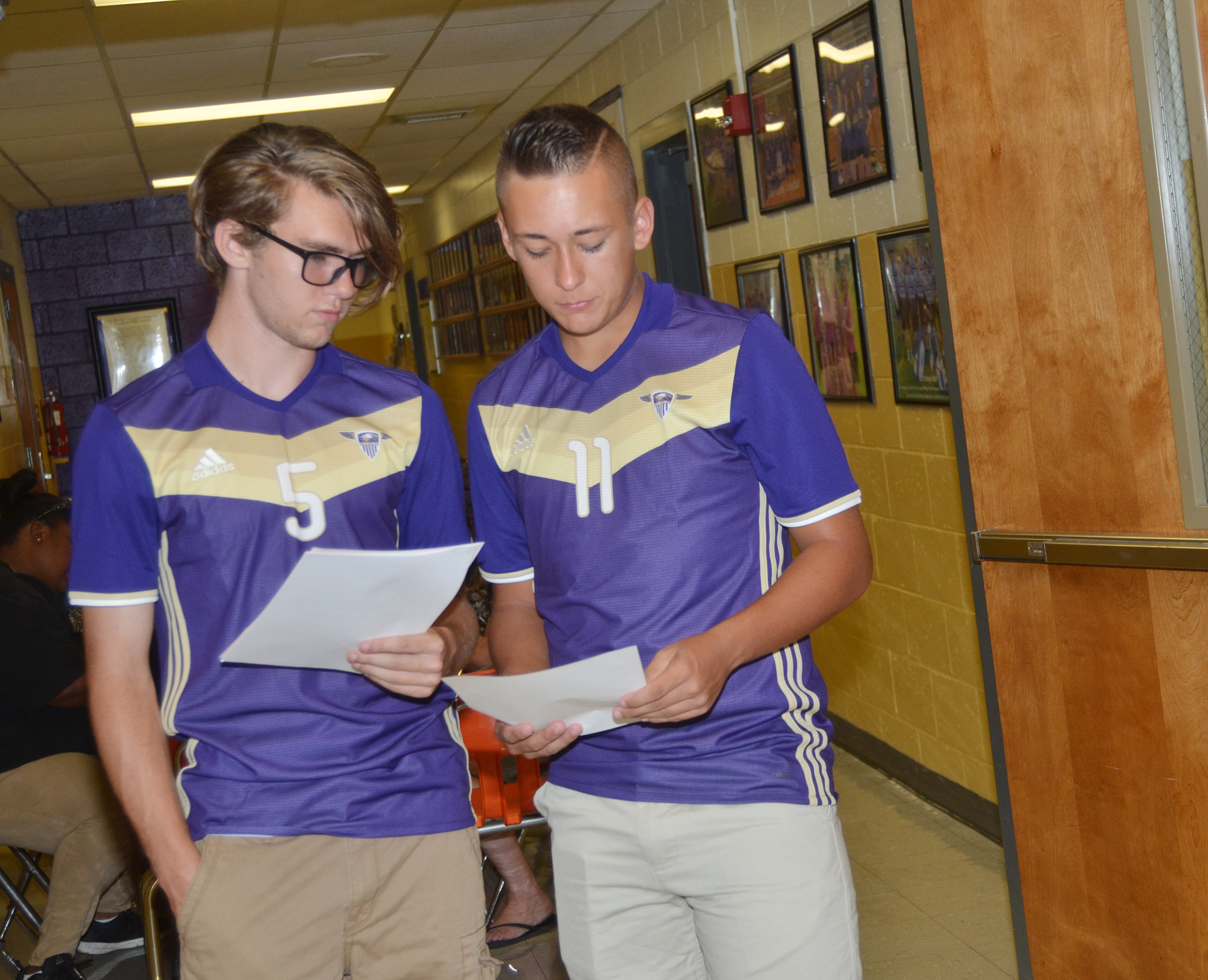 CHS seniors Christian Berry, at left, and Cody Davis compare their schedules.