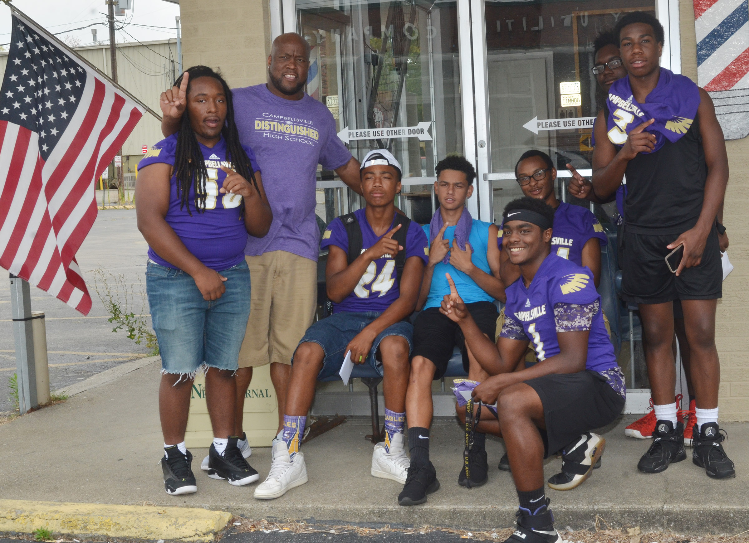 CHS students pose for a photo outside Disco's Chop Shop with exceptional child educator Anthony Epps. From left are junior Ceondre Barnett, Epps, sophomores Lathan Cubit and Mikael Vaught, juniors Charlie Pettigrew and Daesean Vancleave and sophomores Taekwon McCoy and Malachi Corley.