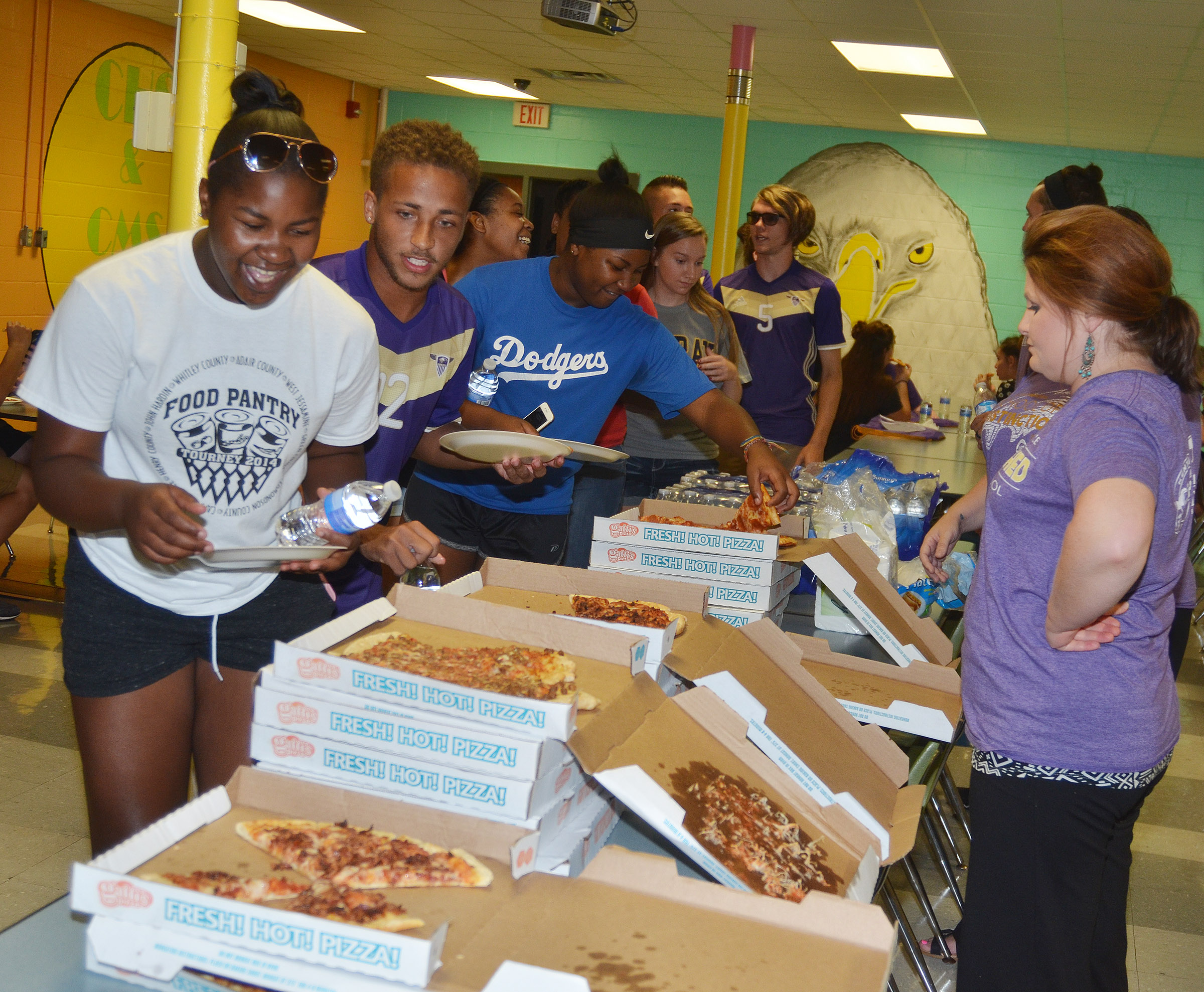 CHS upperclassmen enjoy pizza after their community service project.