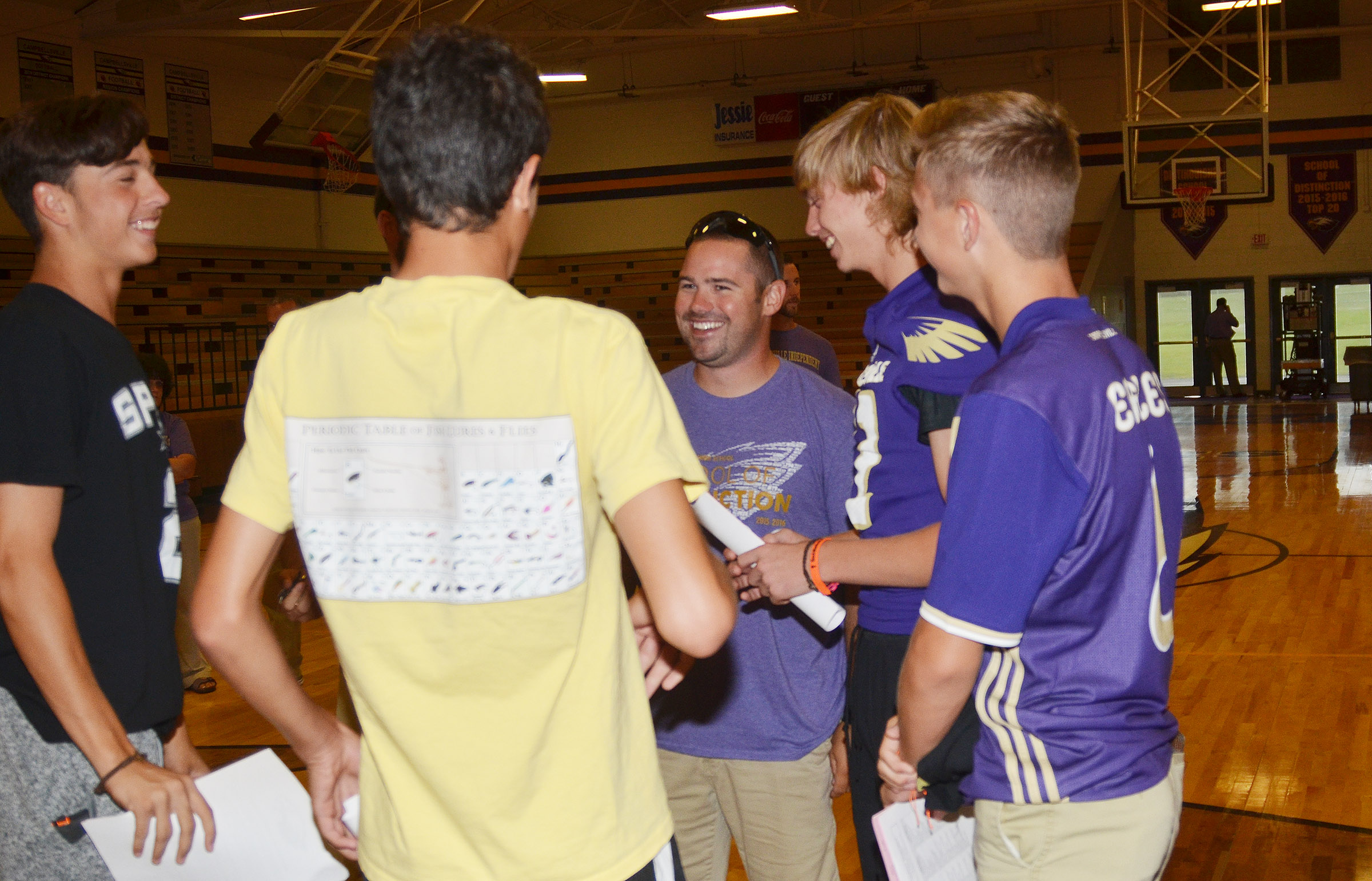 CHS teacher Blake Milby, center, talks with freshmen as they begin a tour of the school.