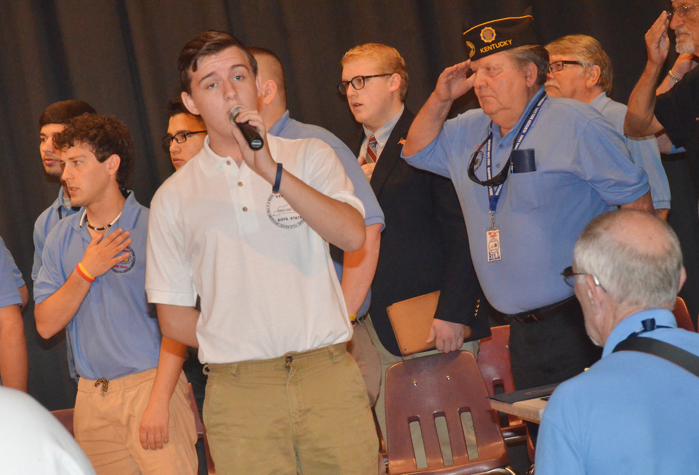 CHS senior Austin Fitzgerald sings the National Anthem at the Boys State graduation ceremony.