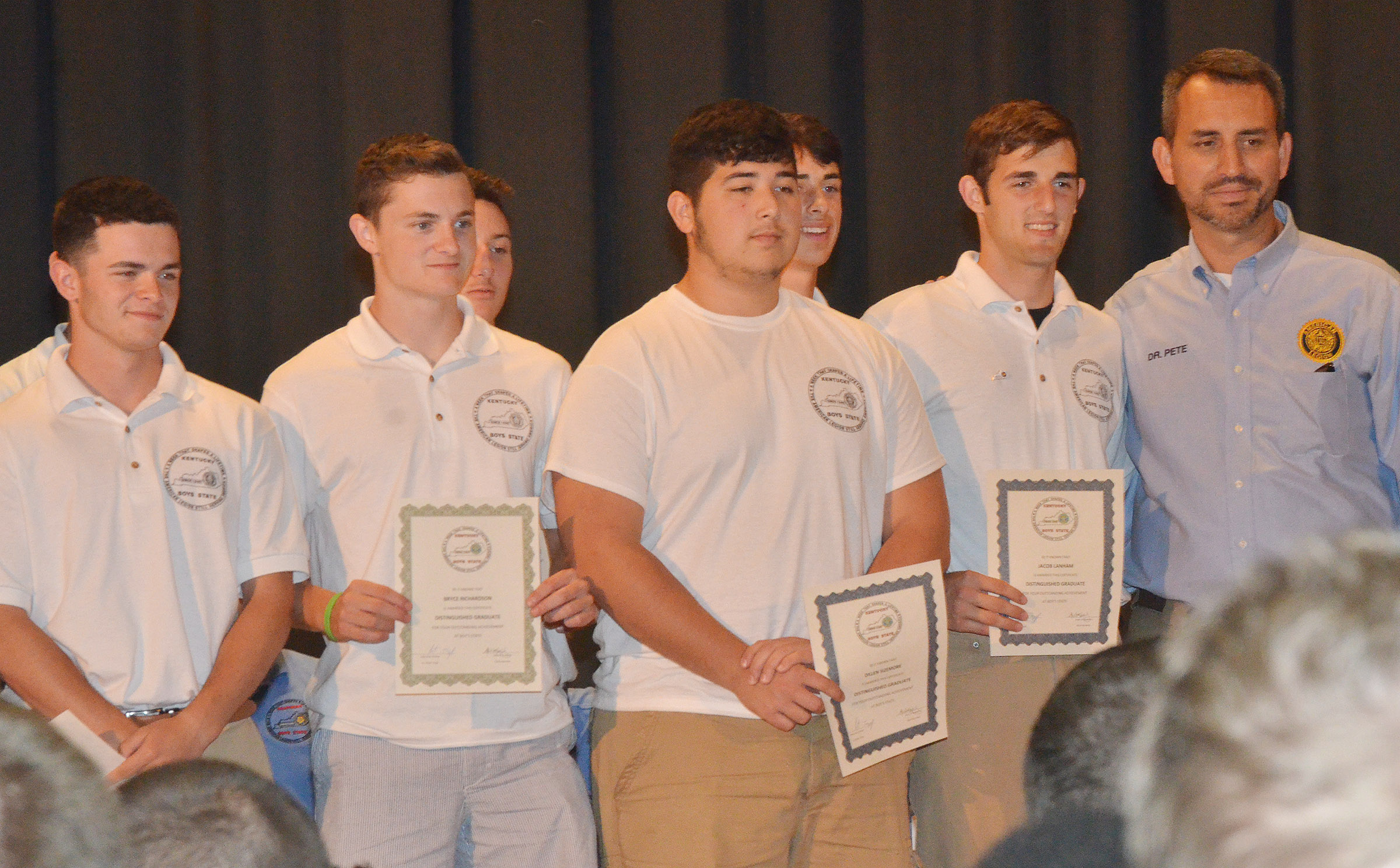 CHS senior Bryce Richardson, second from left, is honored at the Boys State graduation ceremony.