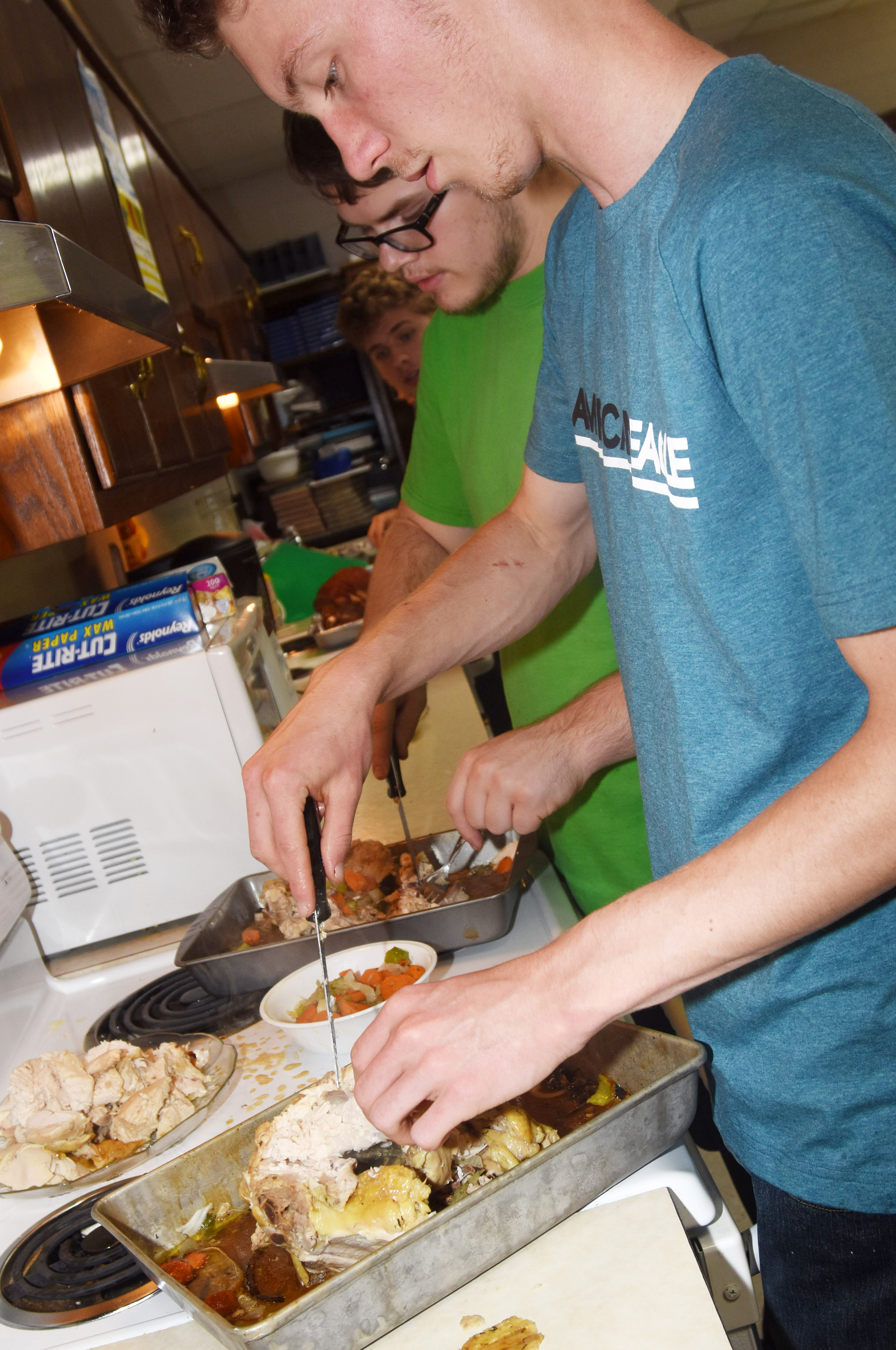 CHS juniors John Netherland, at left, and Payton Reynolds prepare their dish.