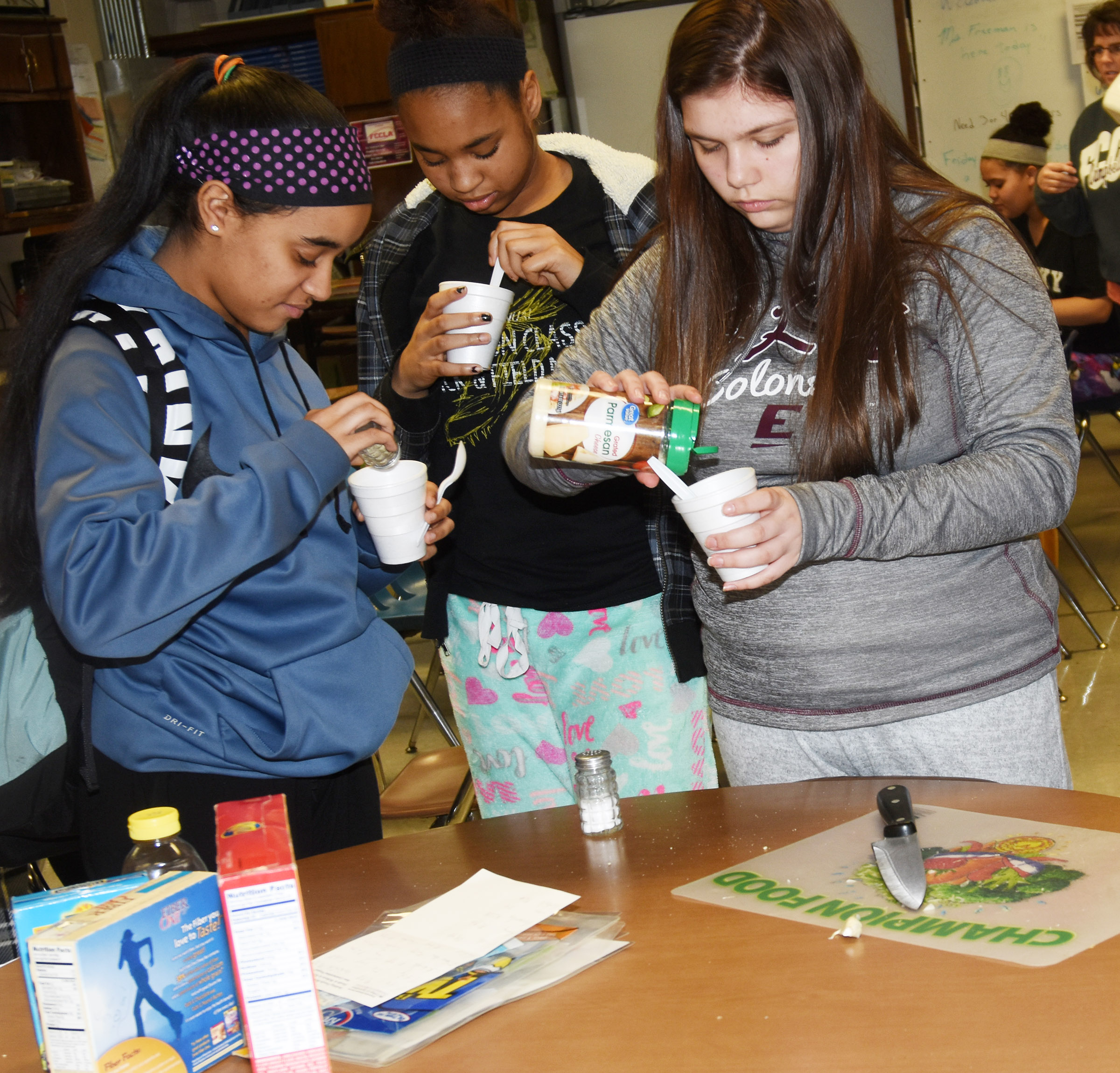 From left, CHS sophomores Jasmine Coro, Isis Coleman and Shelby Hunt sample the class's bean soup.