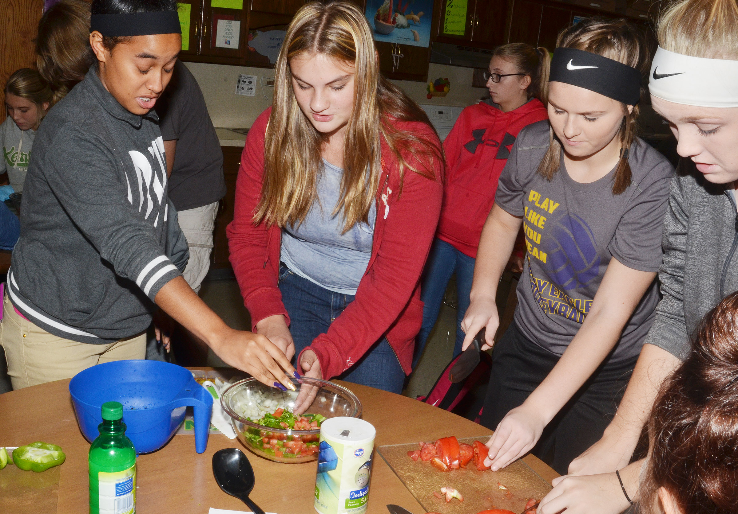 From left, CHS sophomore Jasmine Coro and freshmen Samantha Underwood, Taylor Knight and Catlyn Clausen chop vegetables.