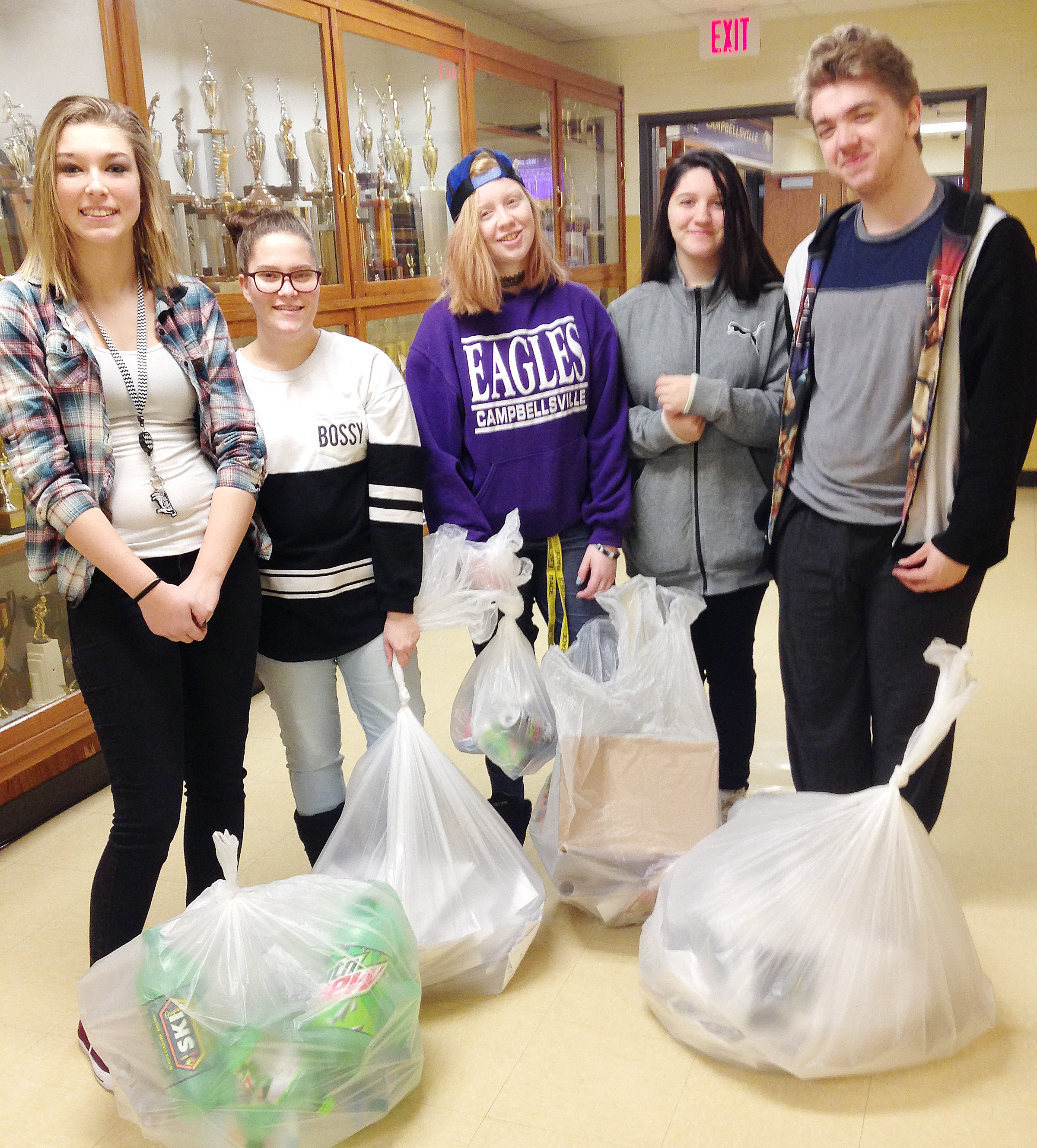 CHS family and consumer science students, from left, freshman Autumn Harvey, sophomore Nevaeh Underwood, senior Elizabeth Golden, freshman Paula Hoskins and sophomore Anthony Shipione collect recycling items at their school. The students, along with several other classmates, coordinate a recycling effort at the CHS campus.