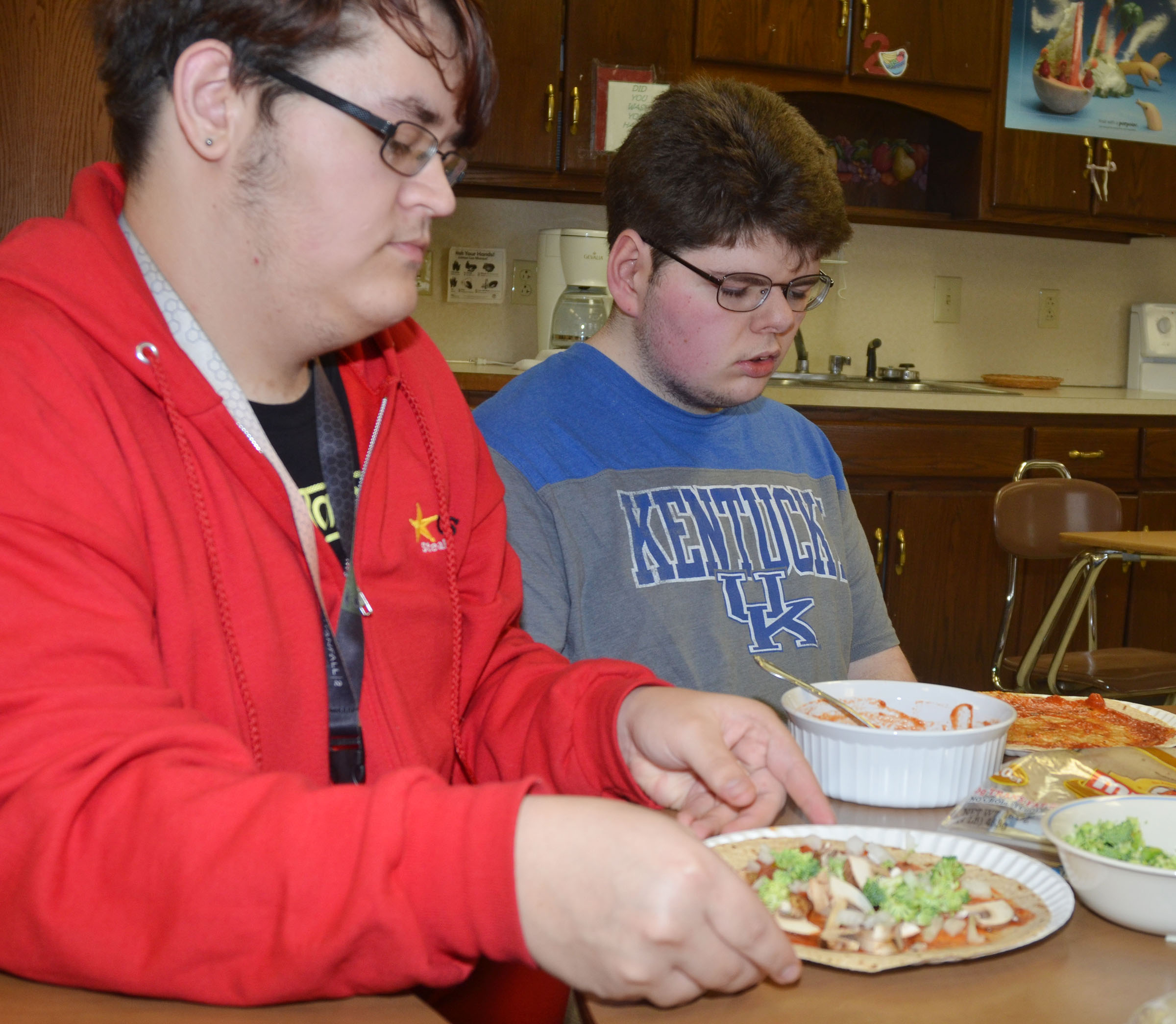 CHS junior Aidan McMahan, at left, and senior Patrick Sapp make their tortilla pizzas.