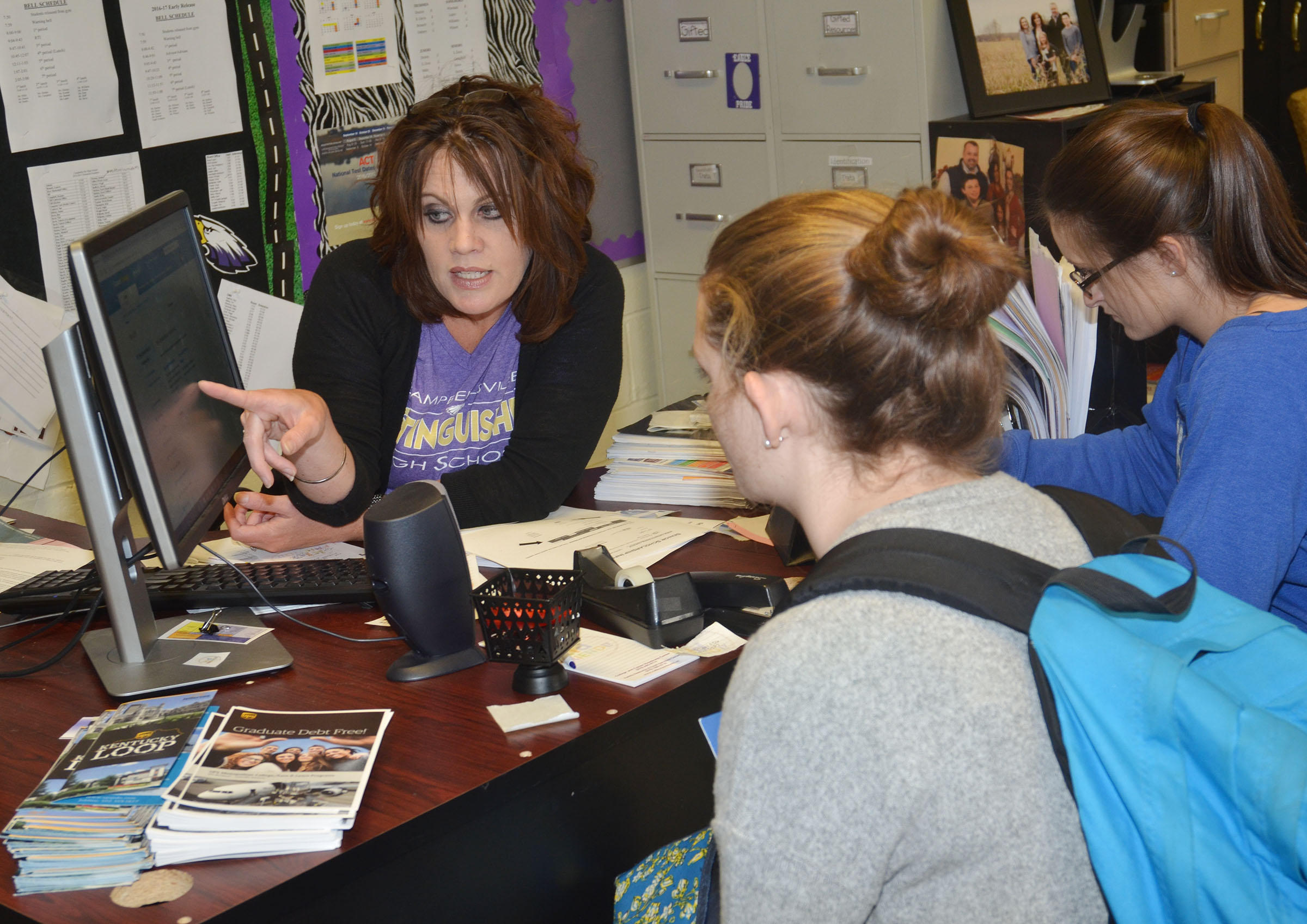 CHS College and Career Readiness Counselor Angie Travis talks to CHS senior Blair Lamb, at left, and junior Kimberly Harden about scholarship application deadlines.
