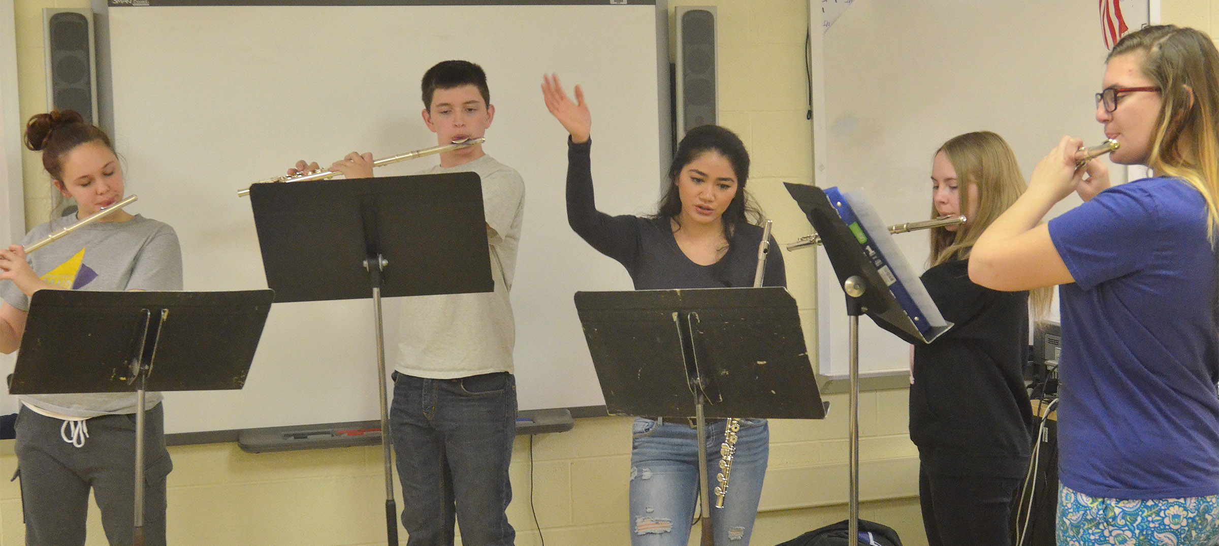 Lindsey Wilson College student Airada Bricker works with flute players, from left, Campbellsville Middle School eighth-grader Mystique Jones, seventh-grader Caden Cowherd, eighth-grader Emily Hayden and CHS junior Tiffany Kane.
