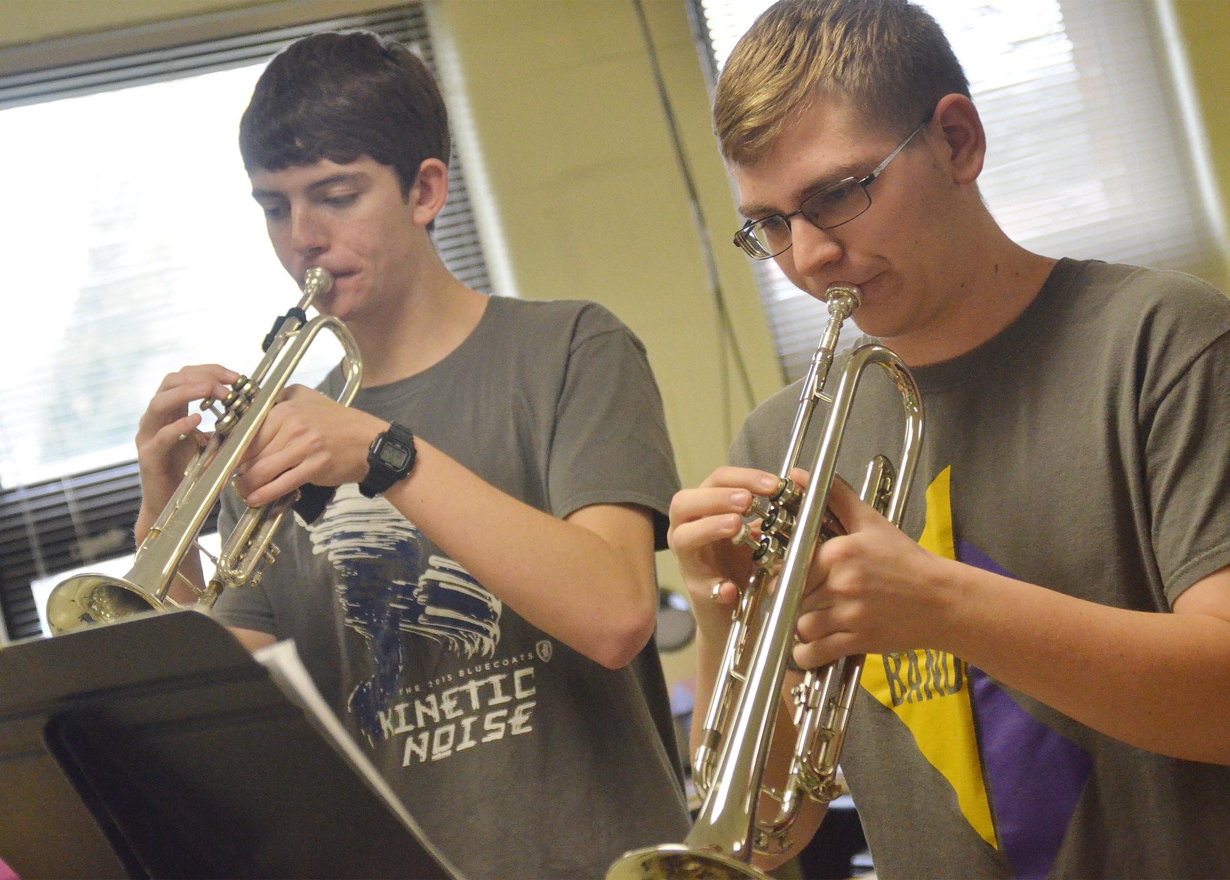 CHS senior Murphy Lamb, at left, and sophomore Brandon Greer play trumpet.
