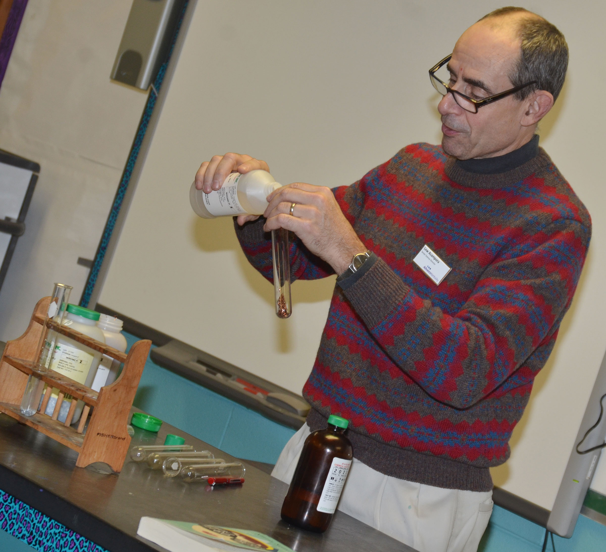 Lew Acampora, senior science director with AdvanceKentucky, mixes copper with hydrochloric acid.