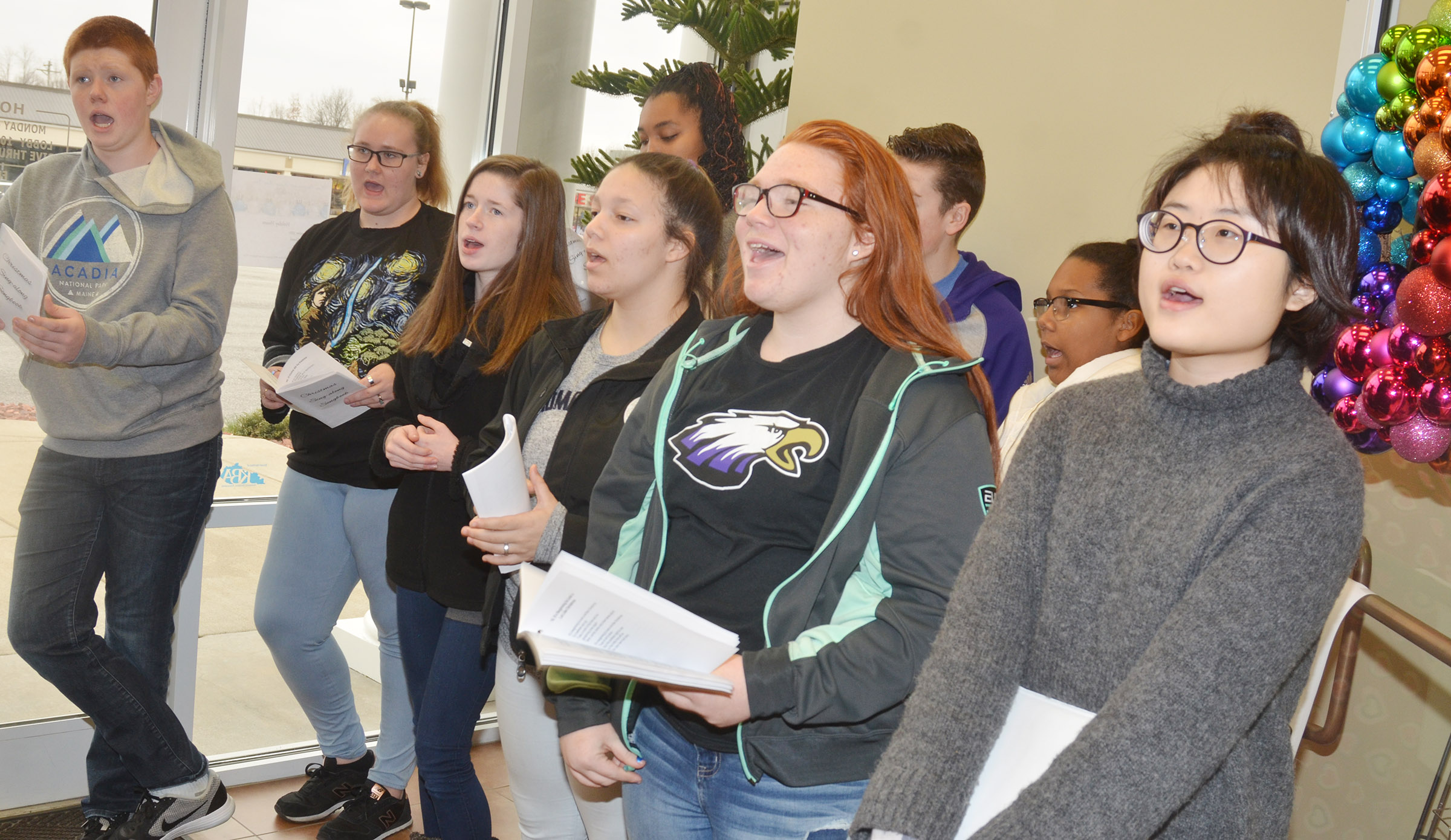 CHS choir members sing Christmas carols at Taylor County Bank. From left, front, are freshman Colin Harris, senior Jay Cox, sophomore Gracyne Hash, freshmen Tierra Bridgewater and Jadelyn Caffee and junior Cherry Kim. Back, junior Malaya Hoskins and sophomores Gavin Johnson and Zaria Cowan.
