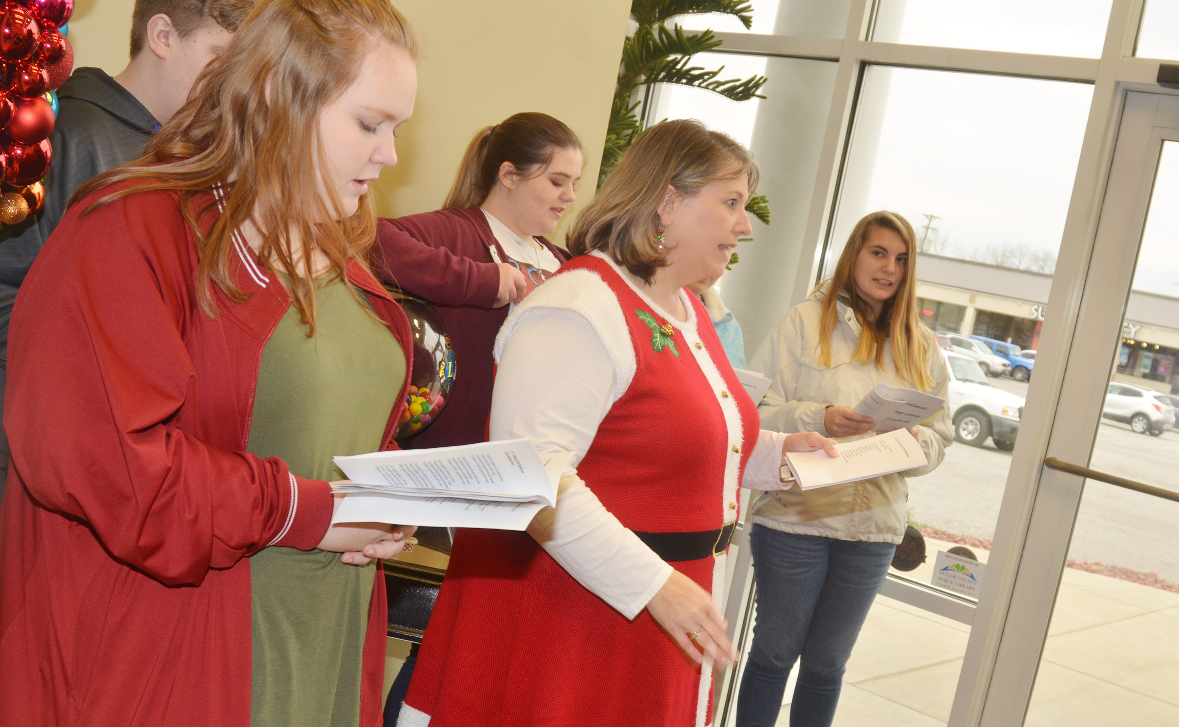 CHS choir members sing Christmas carols at Taylor County Bank. From left, front, are freshman Trinity Lobb and music teacher Cyndi Chadwick. Back, freshman Noah Mardis and seniors Vivian Brown and Tiffany Kane.
