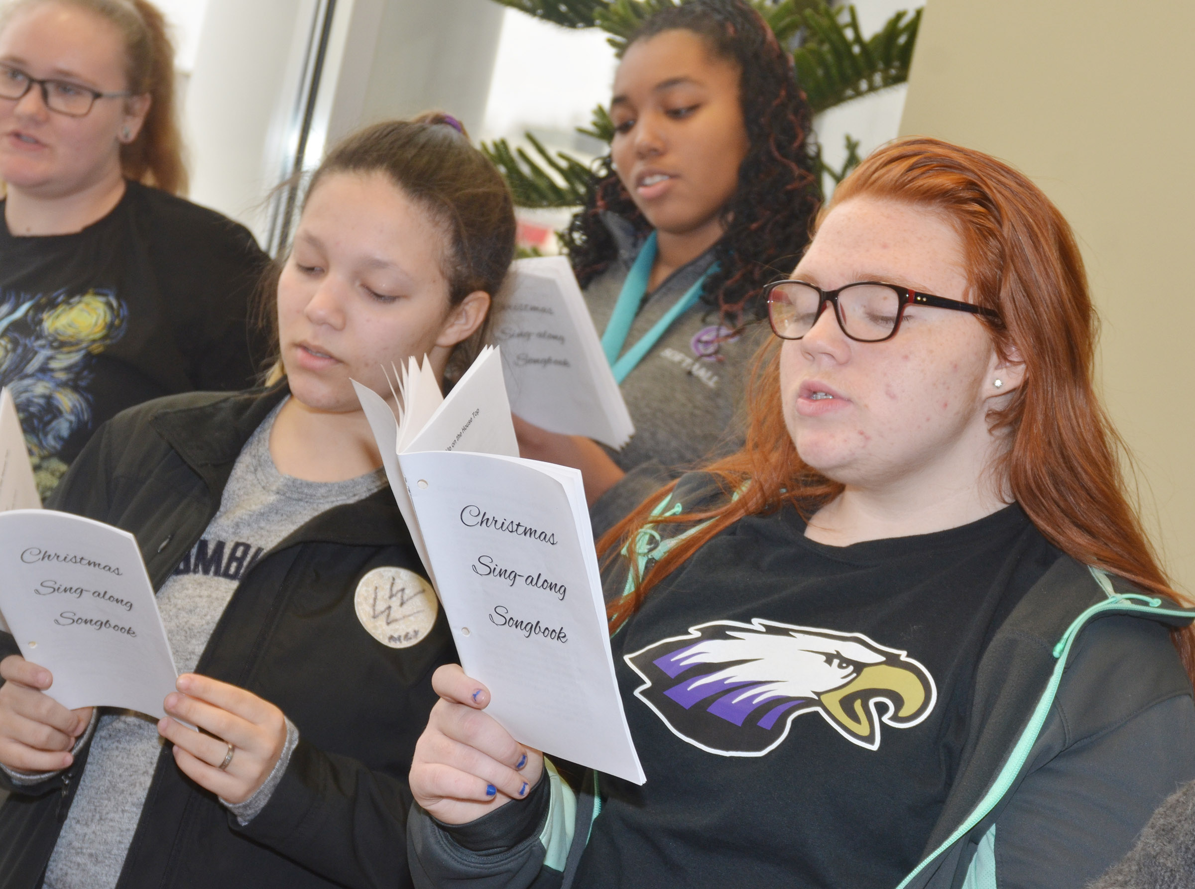 CHS choir members sing Christmas carols at Taylor County Bank. From left, front, are freshmen Tierra Bridgewater and Jadelyn Caffee. Back, senior Jay Cox and junior Malaya Hoskins.