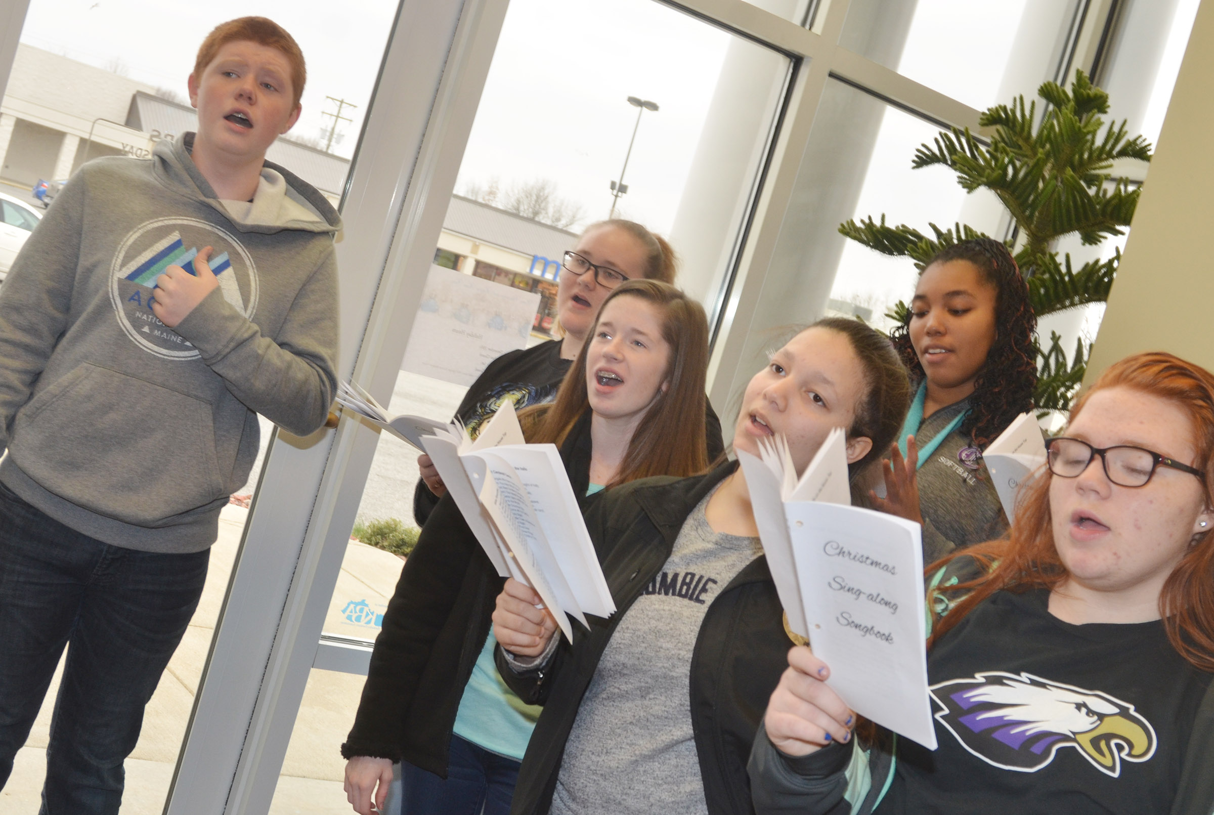 CHS choir members sing Christmas carols at Taylor County Bank. From left, front, are sophomore Gracyne Hash and freshmen Tierra Bridgewater and Jadelyn Caffee. Back, freshman Colin Harris, senior Jay Cox and junior Malaya Hoskins.