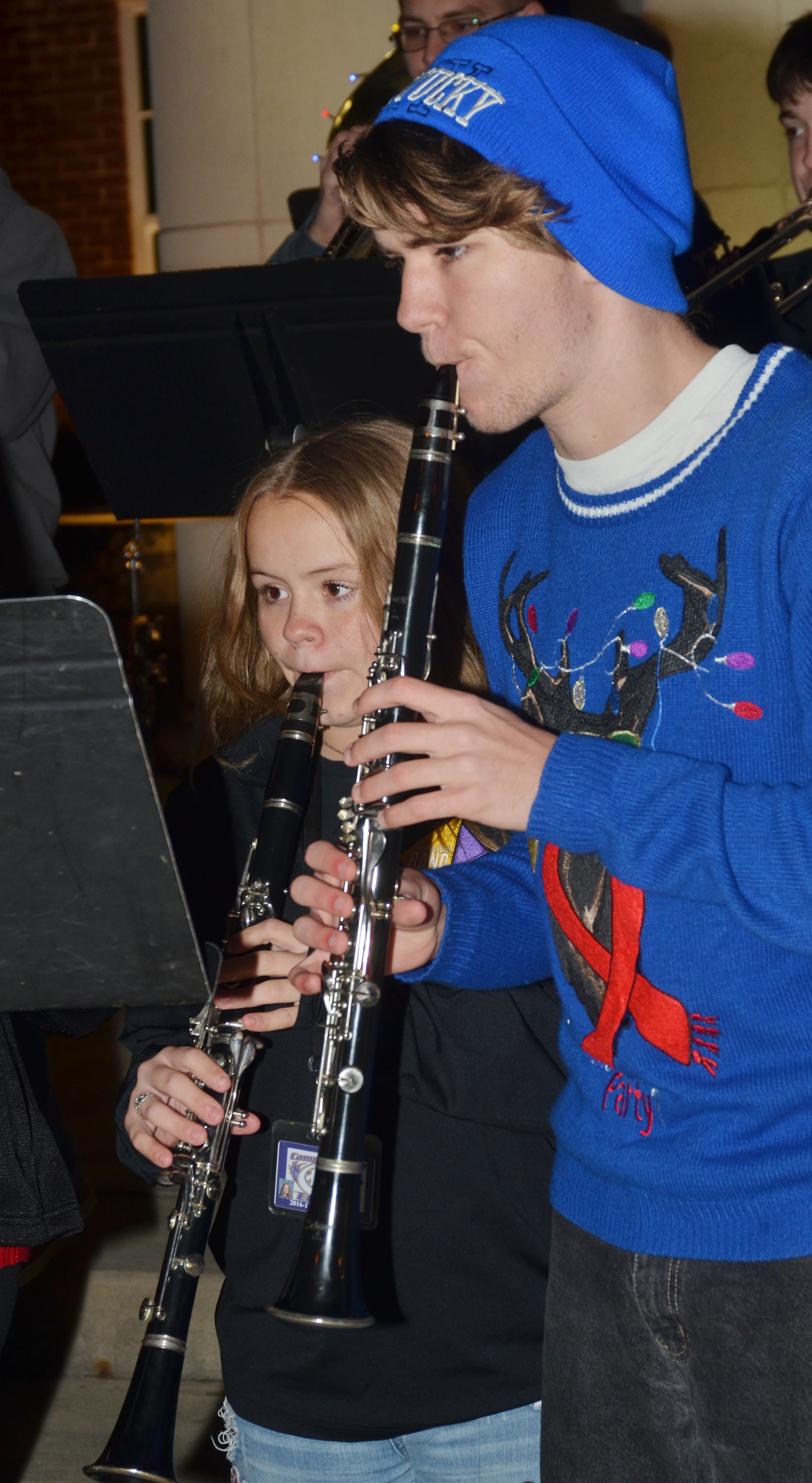 Campbellsville Middle School seventh-grader Riley Rainwater, at left, and CHS junior Christian Berry play clarinet.