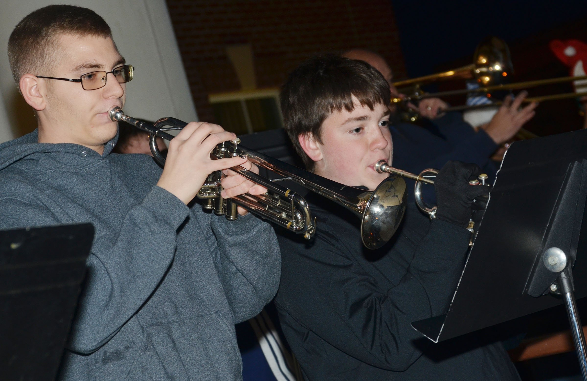 CHS sophomore Brandon Greer, at left, and freshmen Grant Rinehart play trumpet.