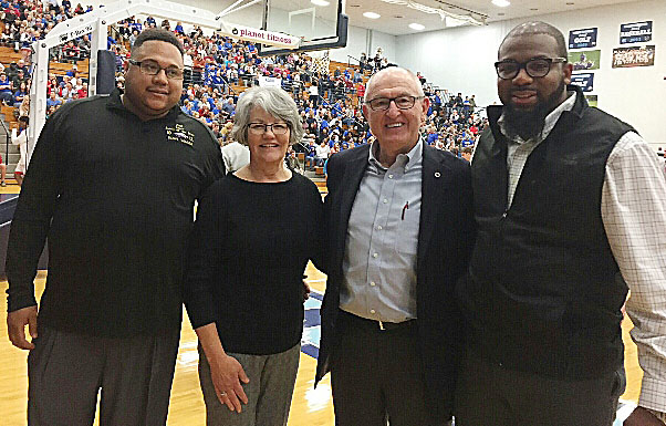 Chuck Vaughn, former Campbellsville Independent Schools superintendent, was recently inducted into the 5th Region Athletic Director's Hall of Fame and was honored at the 5th region boys' basketball championship game on Tuesday, March 7. He is pictured with, from left, Bronson Gowdy, Campbellsville middle and high school assistant football coach, his wife Karen and CHS football and boys' basketball assistant coach Will Griffin.