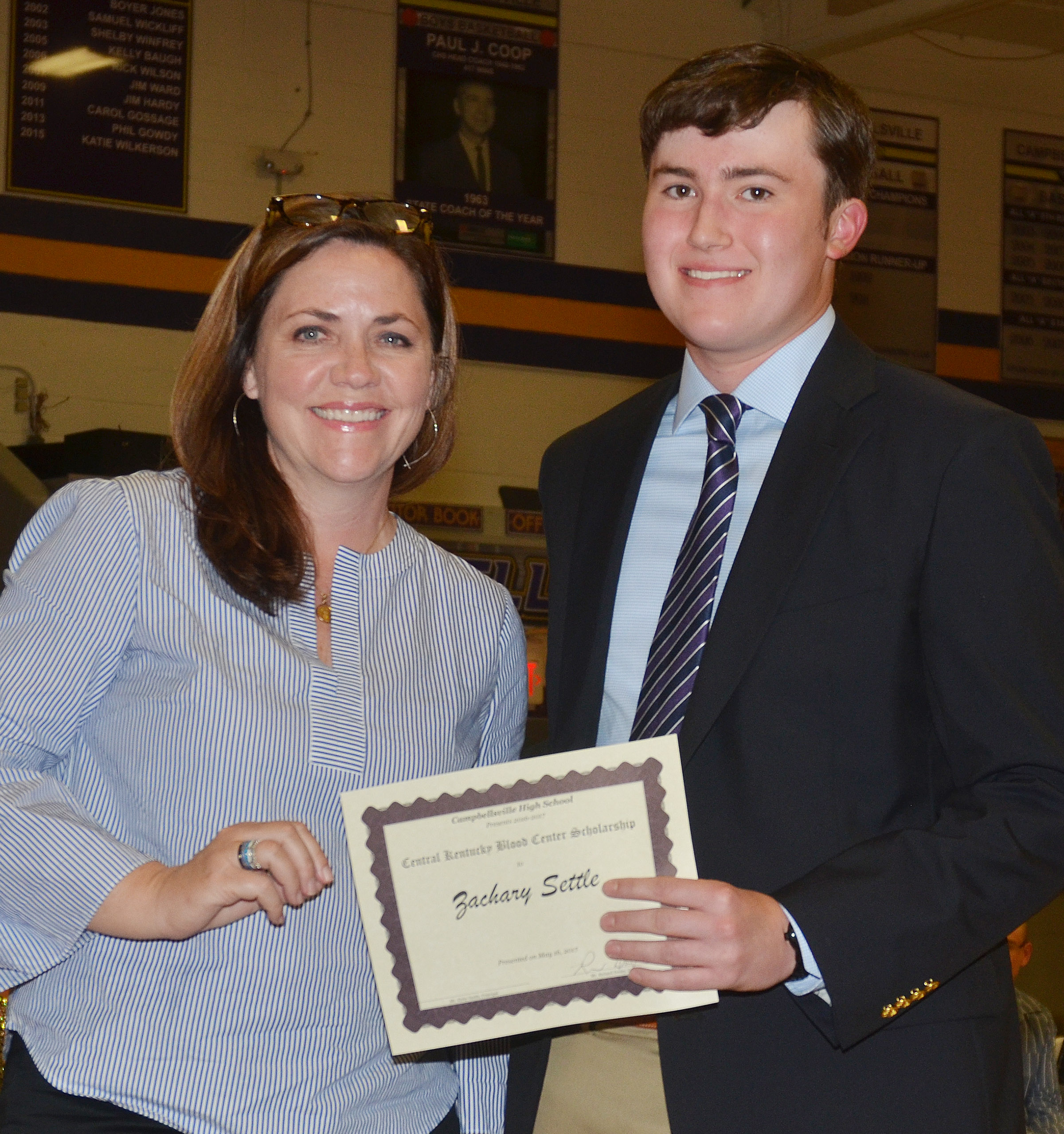 Zack Settle receives a Central Kentucky Blood Center scholarship from CHS teacher Susan Dabney.