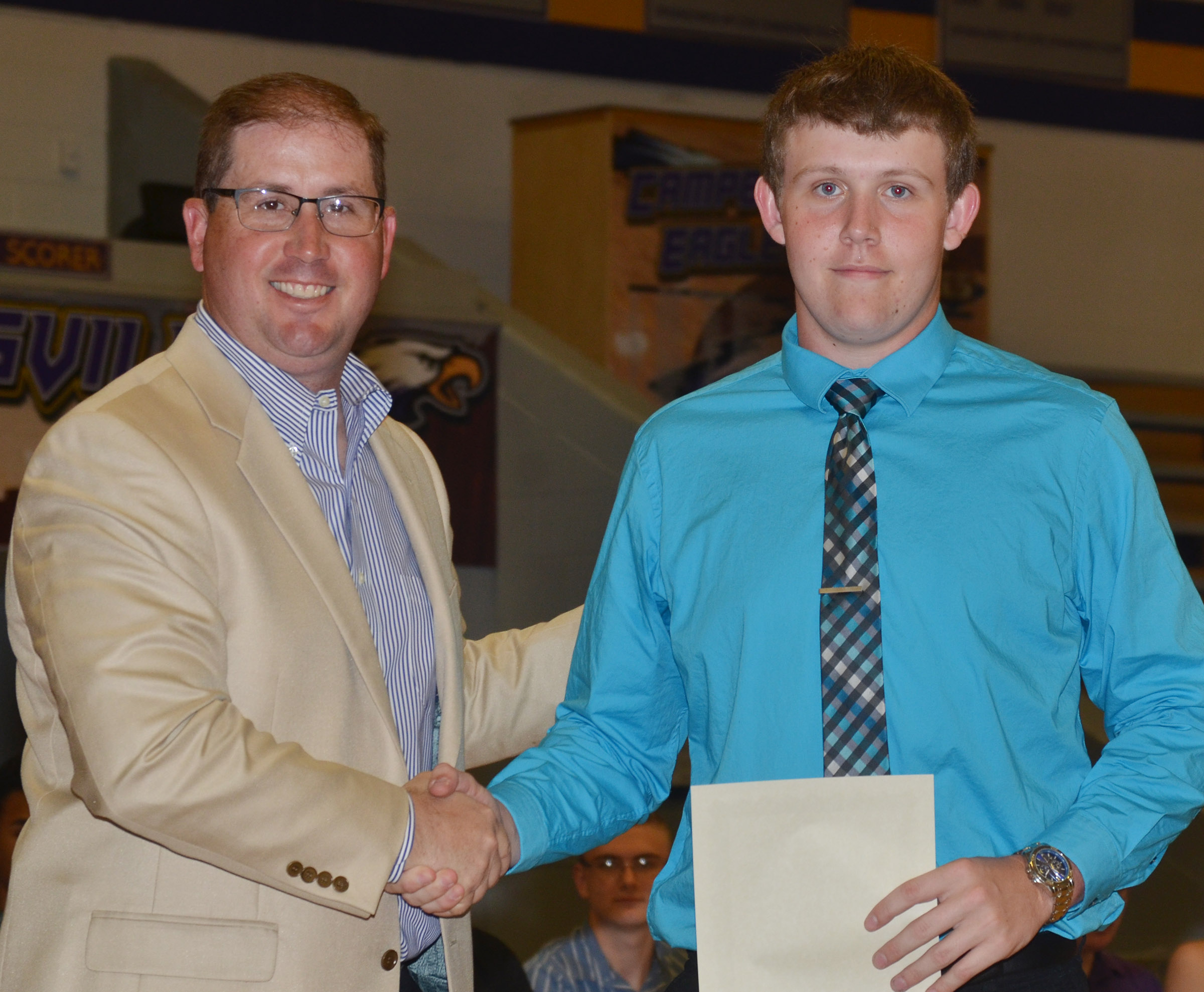 Jared Brewster receives the Taylor County Farm Bureau Federation scholarship from agent Darin Price.