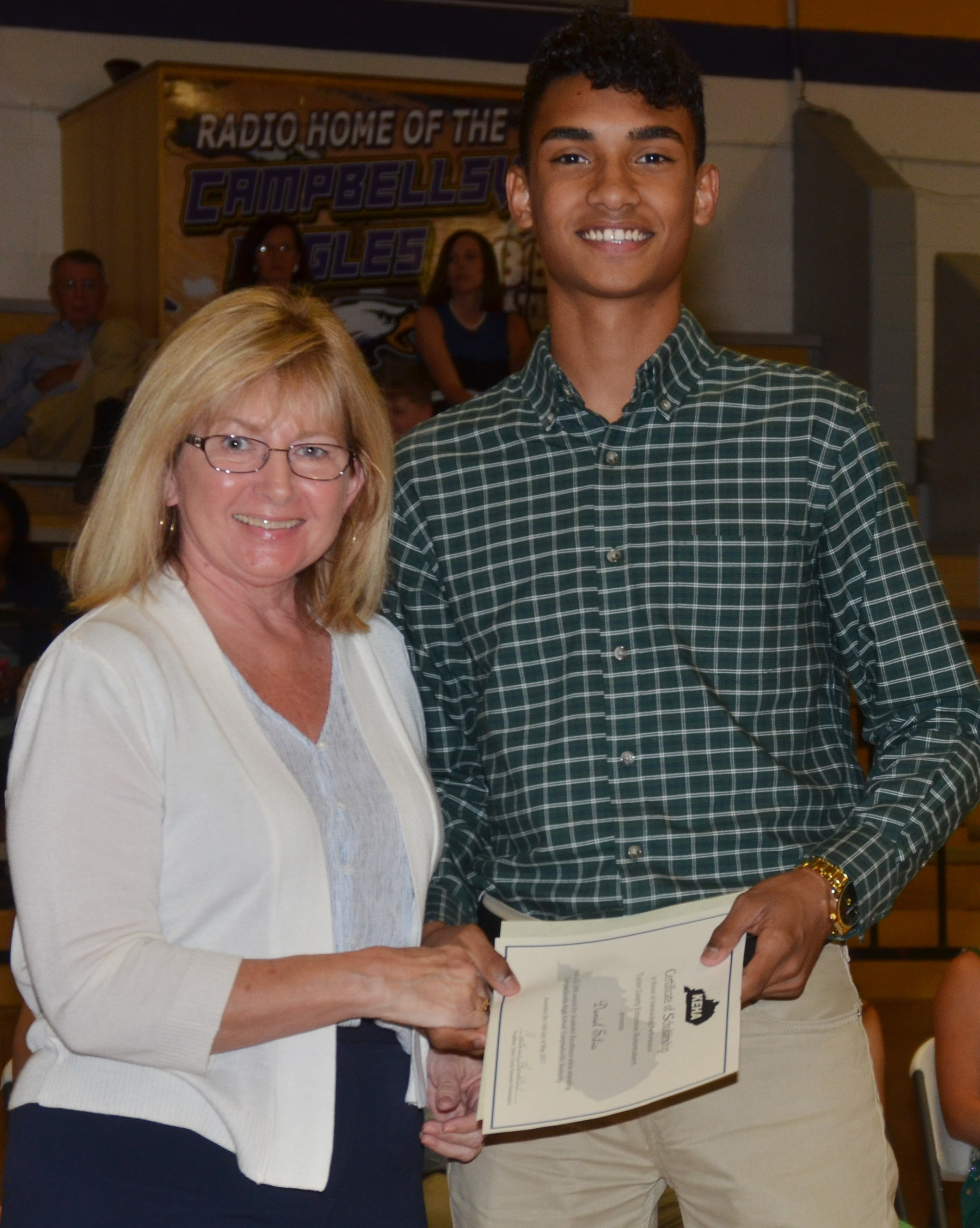 Daniel Silva receives the Taylor County Homemakers Extension Office scholarship from Cyndy Humble.