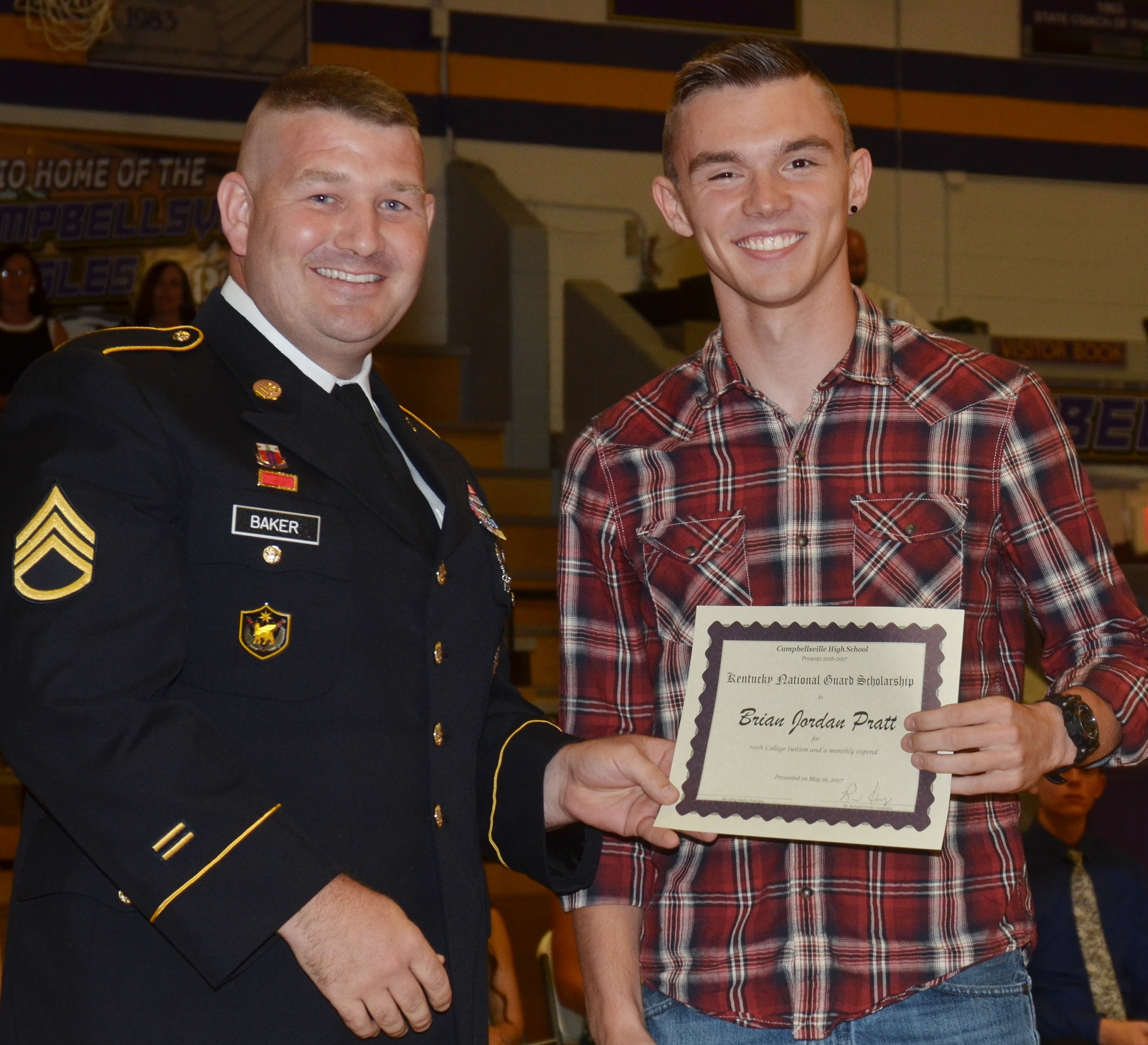Jordan Pratt receives recognition from Sgt. Phillip Baker of the National Guard.
