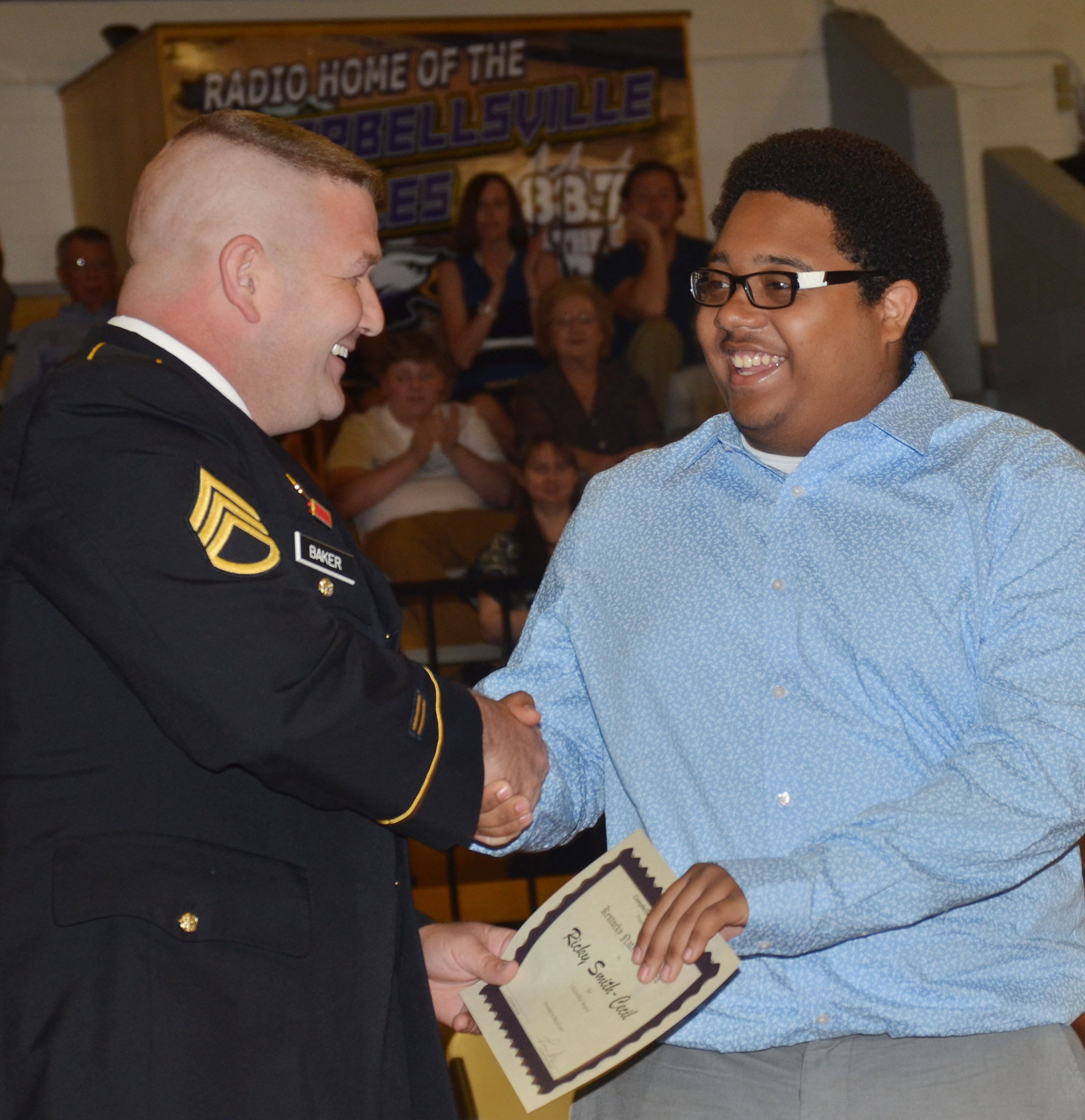 Ricky Smith-Cecil receives recognition from Sgt. Phillips Baker of the National Guard.