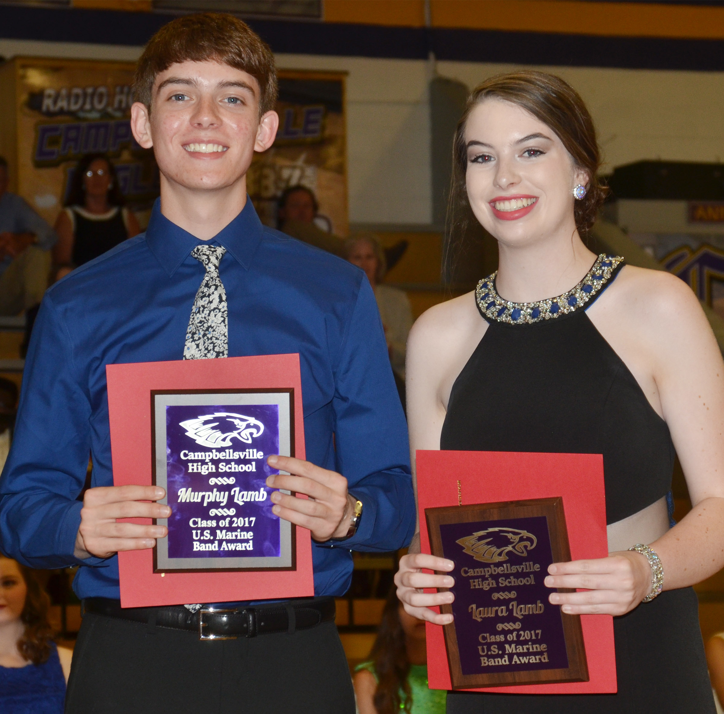 Murphy Lamb and Laura Lamb receive the U.S. Marine Band awards.