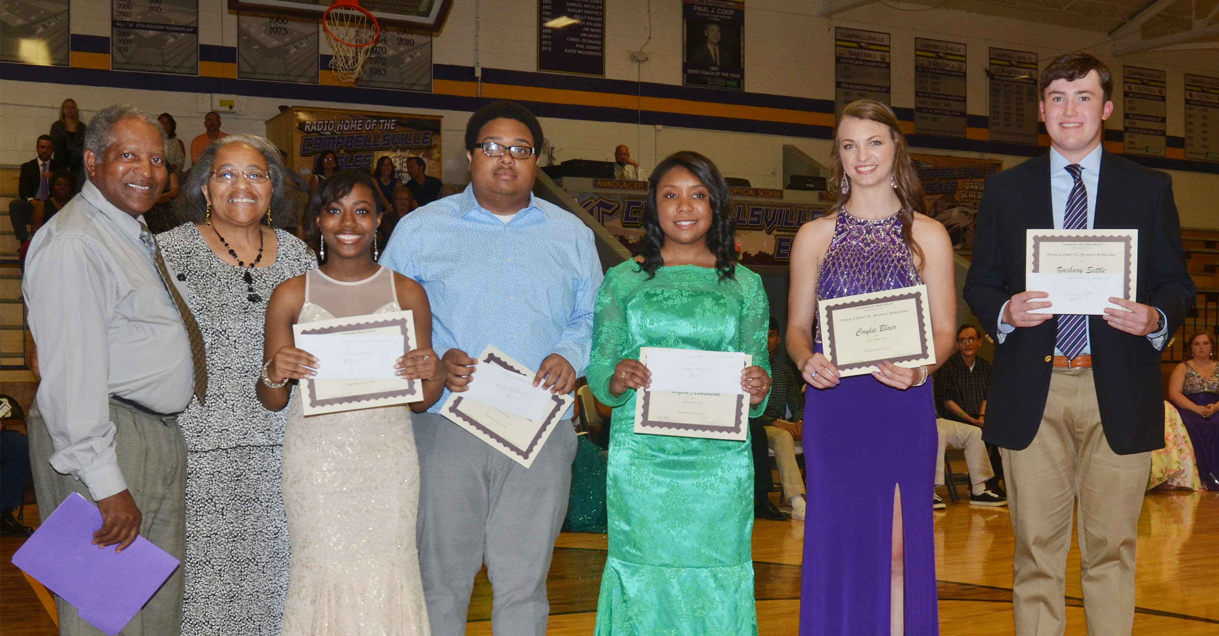Receiving the George Caldwell Jr. Memorial Scholarship from Michael Caldwell and Rose Jones, at left, are, from left, Latavia Shively, Ricky Smith-Cecil, Kayla Atkinson, Caylie Blair and Zack Settle.