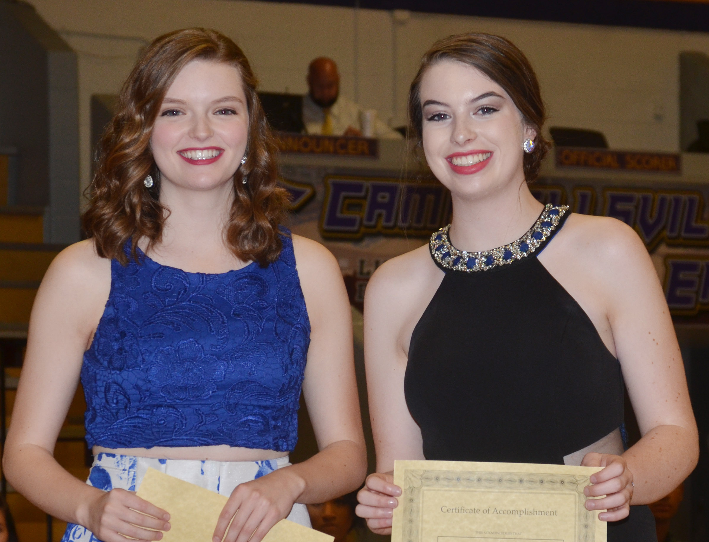 Blair Lamb, at left, and Laura Lamb are honored for being named Taylor County Distinguished Young Woman and the second runner-up, respectively. Blair was also fourth runner-up at the Kentucky DYW program.