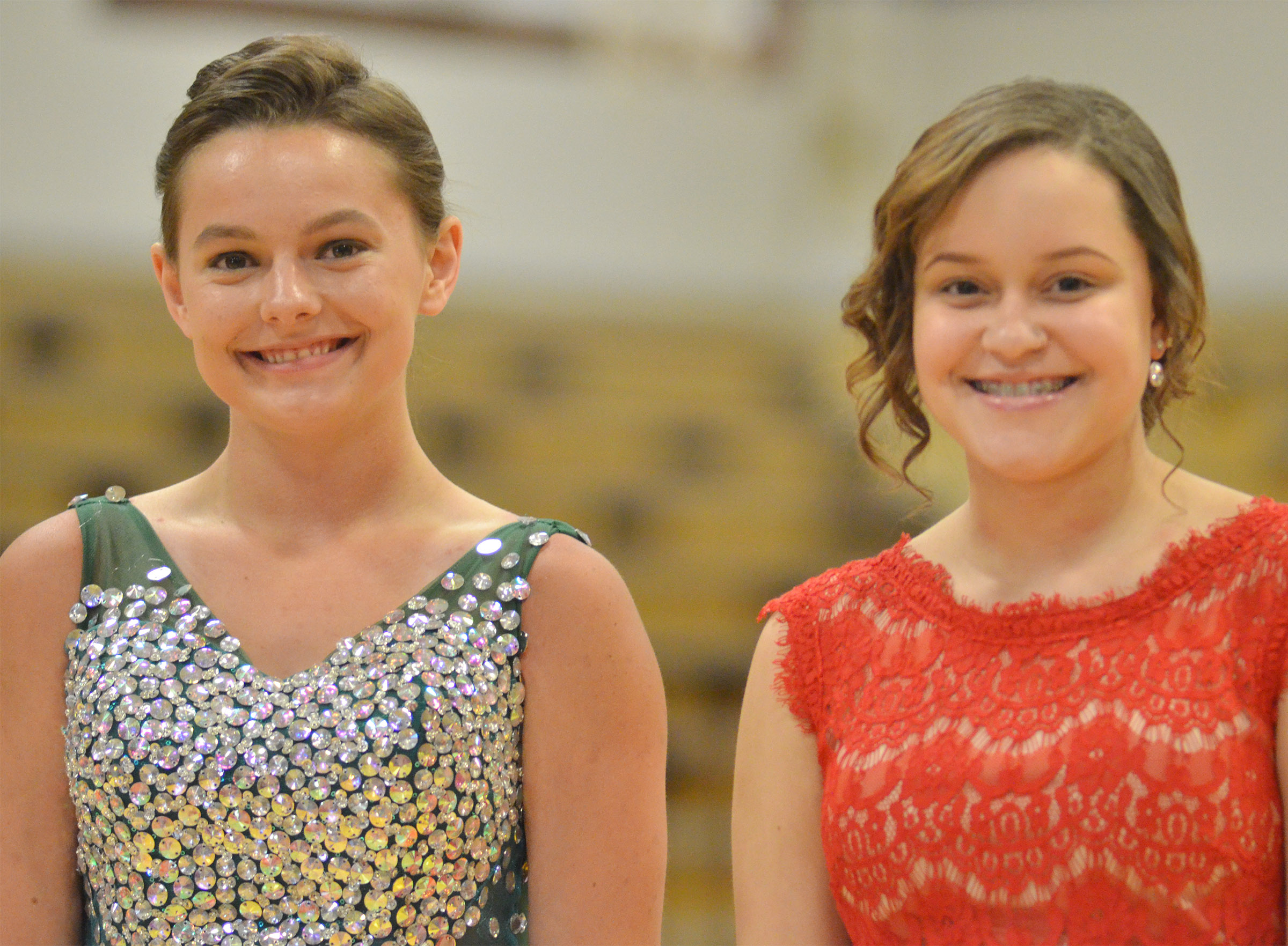 Kyrsten Hill, at left, and Breanna Spaulding smile as they walk into the gym.