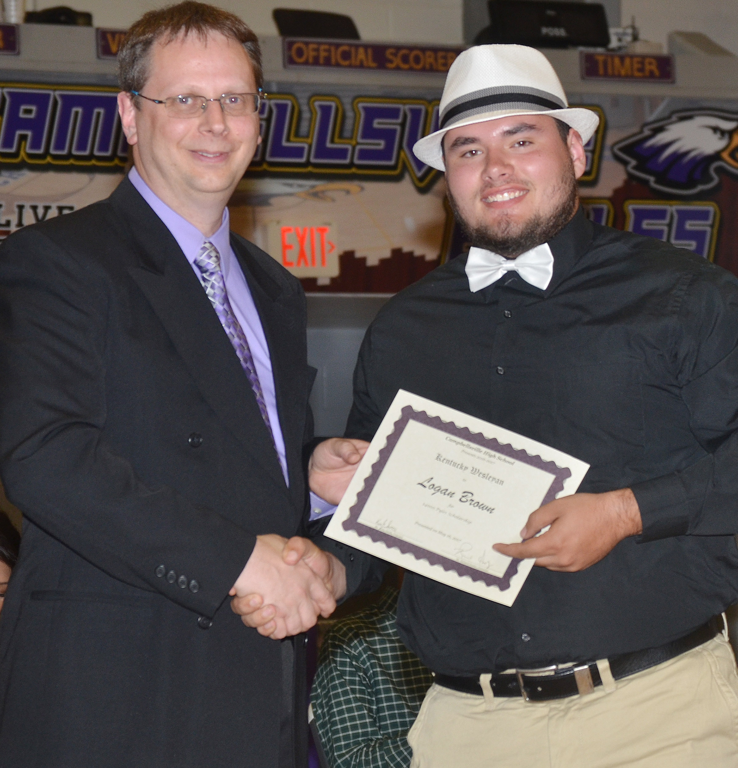 Logan Brown receives the Pyles Scholarship from Kentucky Wesleyan College. He is pictured with guidance counselor Richard Dooley.