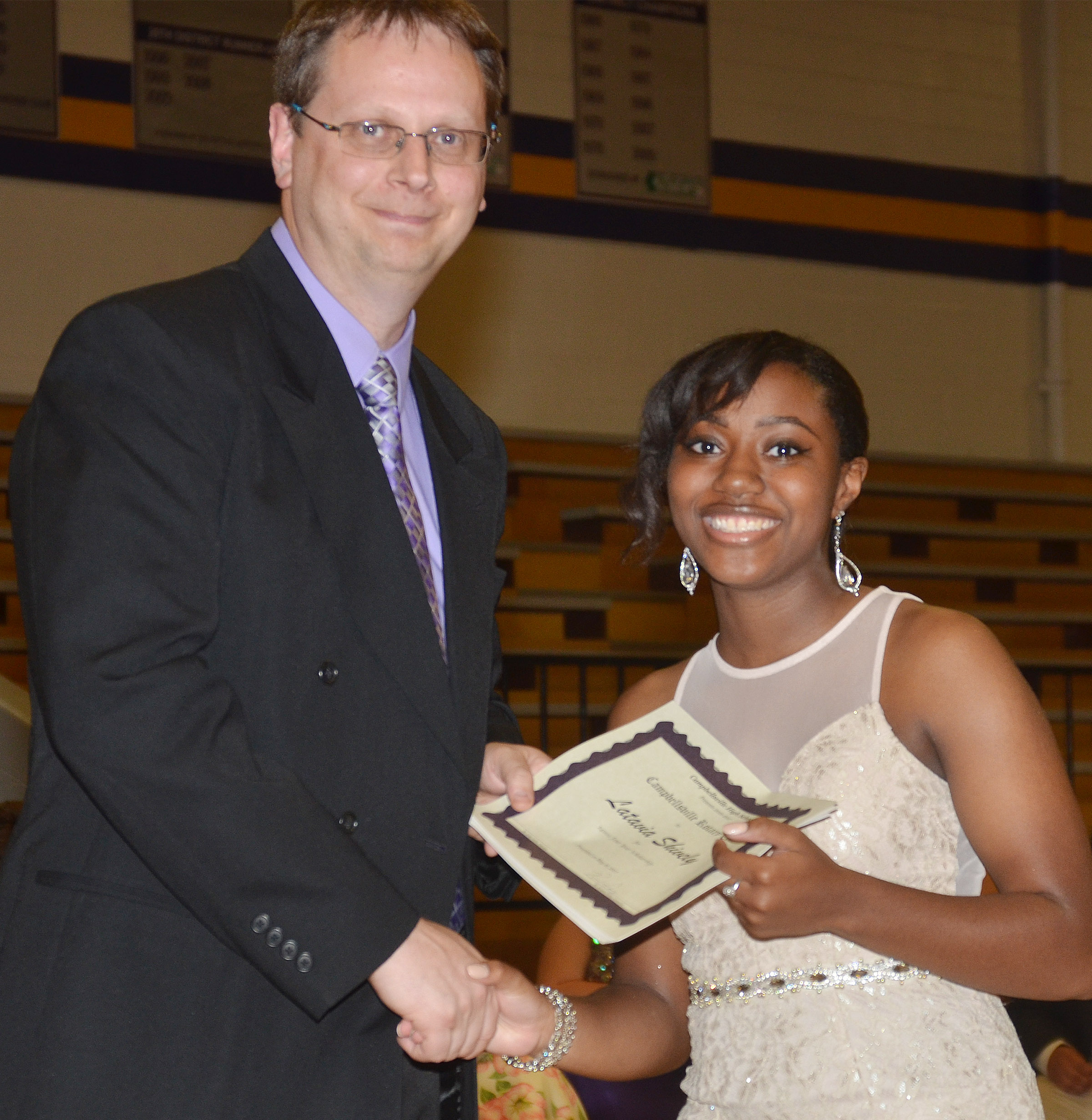Latavia Shively receives the Campbellsville Rotary Club scholarship. She is pictured with guidance counselor Richard Dooley.